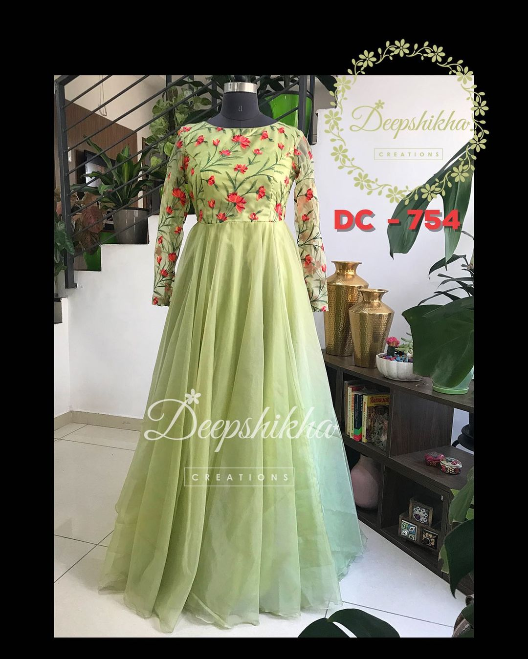 DC - 754. Stunning olive green color floor length dress floral design on yoke.