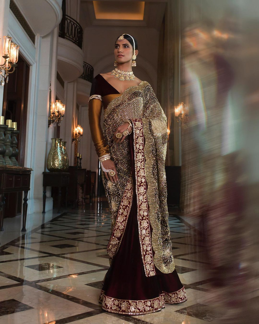 Manish Malhotra two-tone Regal Ruhaaniyat Saree with nakshi embroidery and an intricate zardosi border paired with our signature colour-block blouse echoes the soulful opulence of the Awadhi magnificence. | black georgette saree | white designer saree | plain white saree online | 2020-12-21