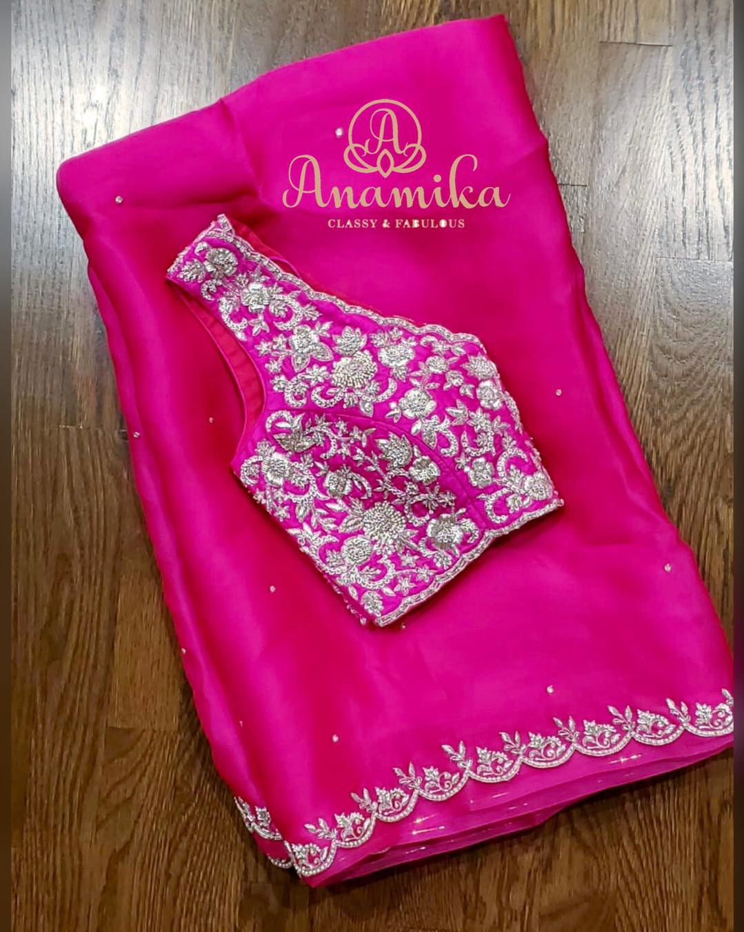 Did you say you were looking for a Cocktail saree ?? Check out this beautiful satin organza saree in a bright pink shade with silver zardosi work all over !! What's stunning
