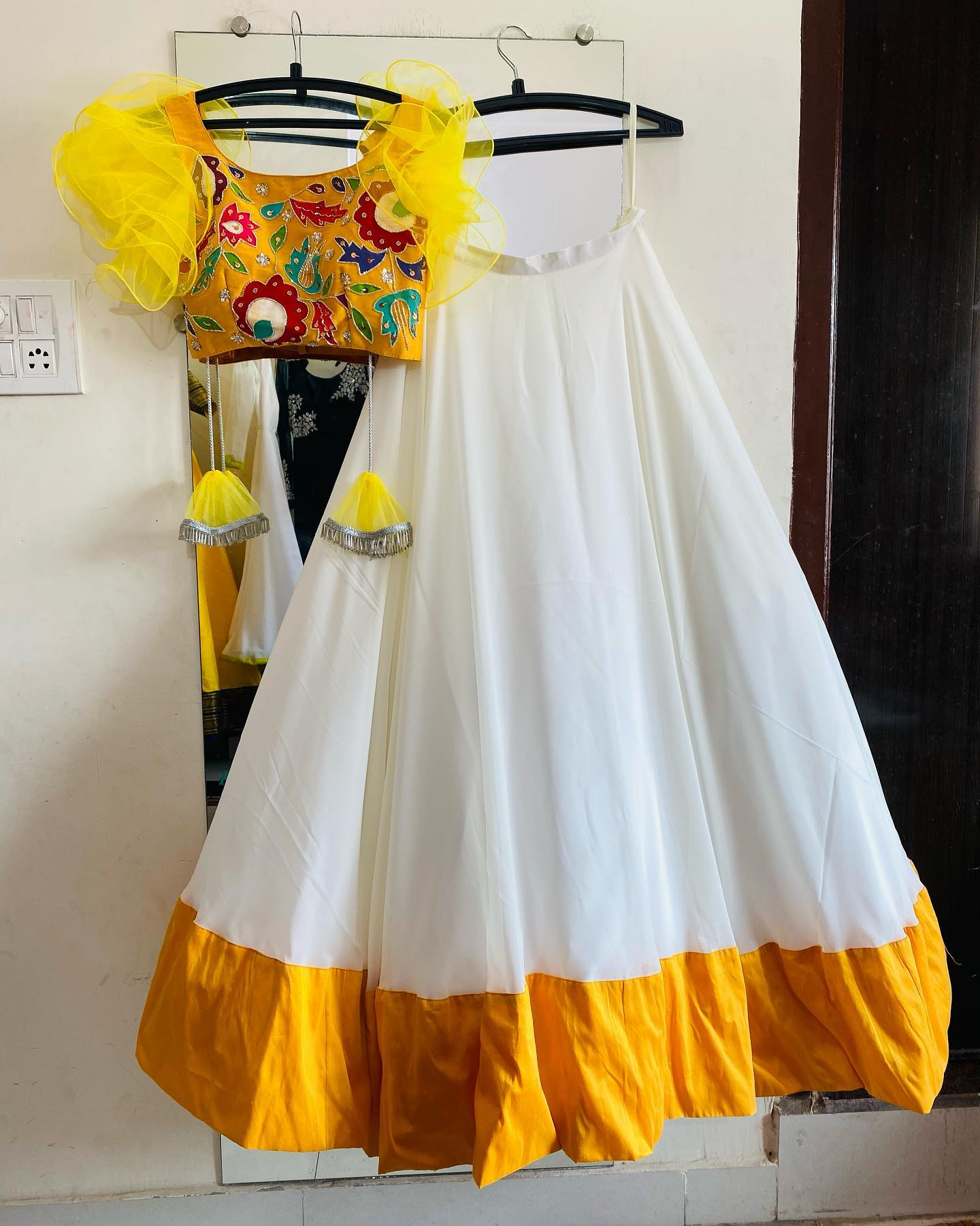 Customised Haldi outfit. Stunning pearl white color skirt and yellow color crop top. blouse with ruffle sleeves. | lehenga choli for women | engagement lehenga | new net lehenga | 2020-12-22