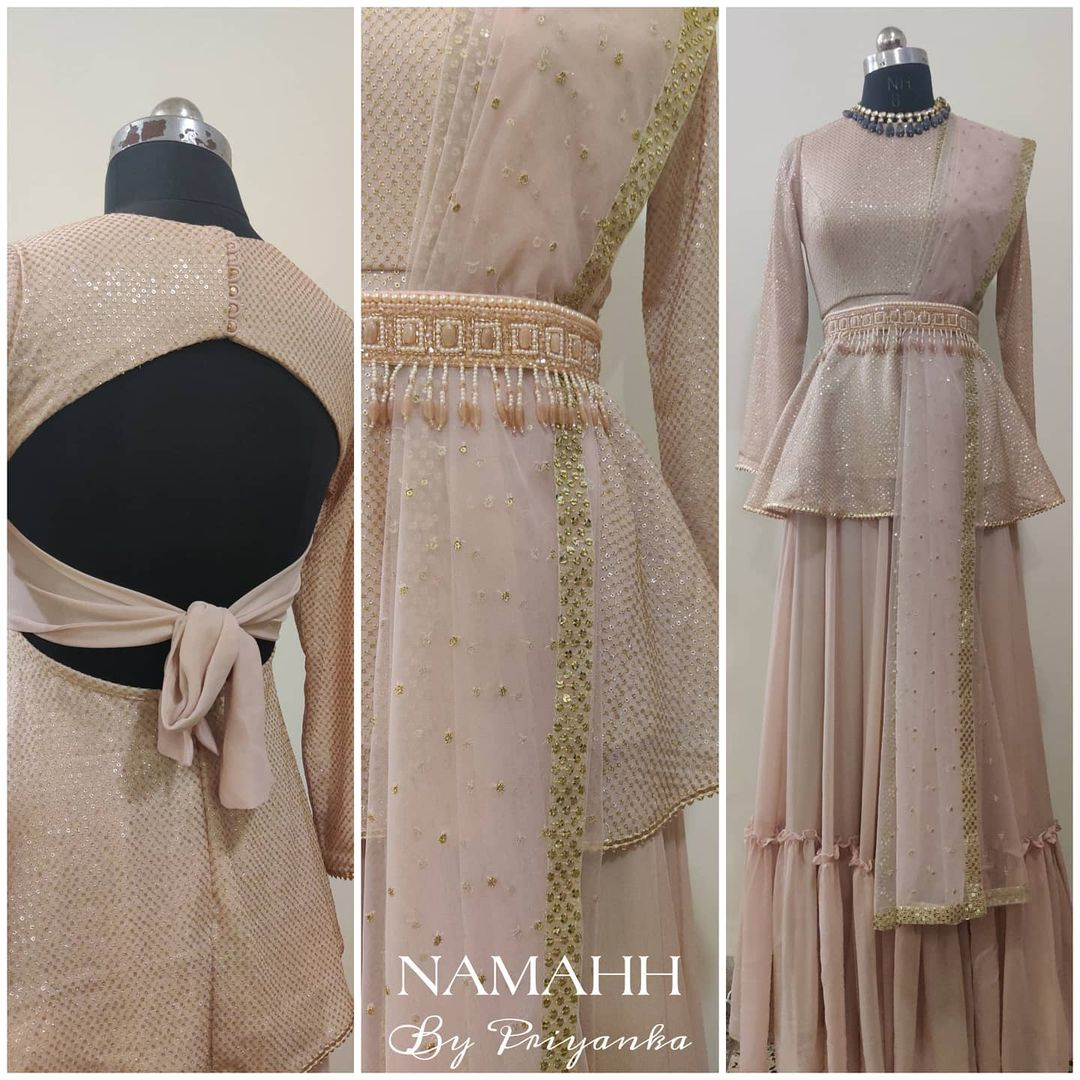Stunning blush pink color peplum top and skirt with hand embroidery waist belt.  |  |  |  | 2020-12-22
