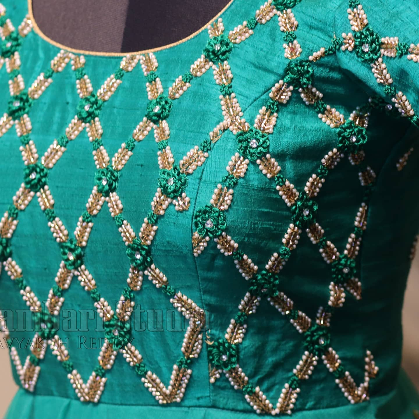 Beautiful bottle green color  floor length dress with floral design hand embroidery thread and bead work allover.  2020-12-26