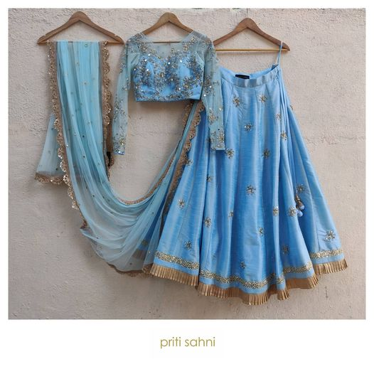 Sun and Sky.  The early morning magic with glittering dew drops and rays of sun playing hide and seek in the clear blue sky!  Contemporary mirror thread and beads work blouse with raw silk with skirt with embroidered buttis and dupatta with mirror work  all in powder blue.  To get your dream outfit designed DM or Whatsapp on +91-9022617481 2020-12-26