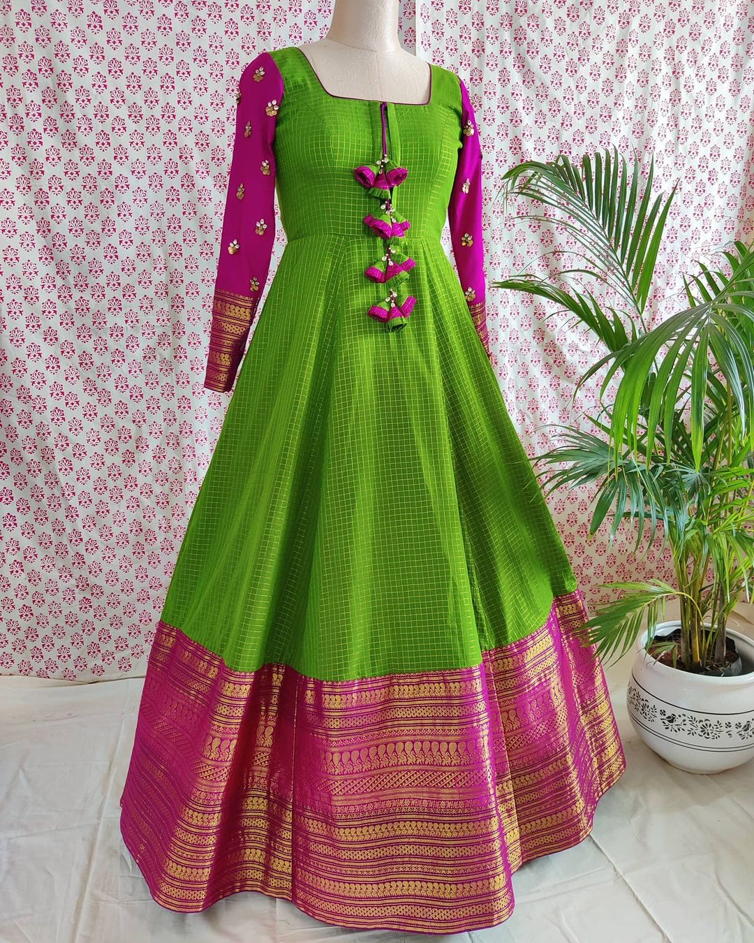 Classic old school colour combinations - an ideal choice for festivity . Beautiful parrot green and pink color combination pattu long frock with full sleeves. 2020-12-30