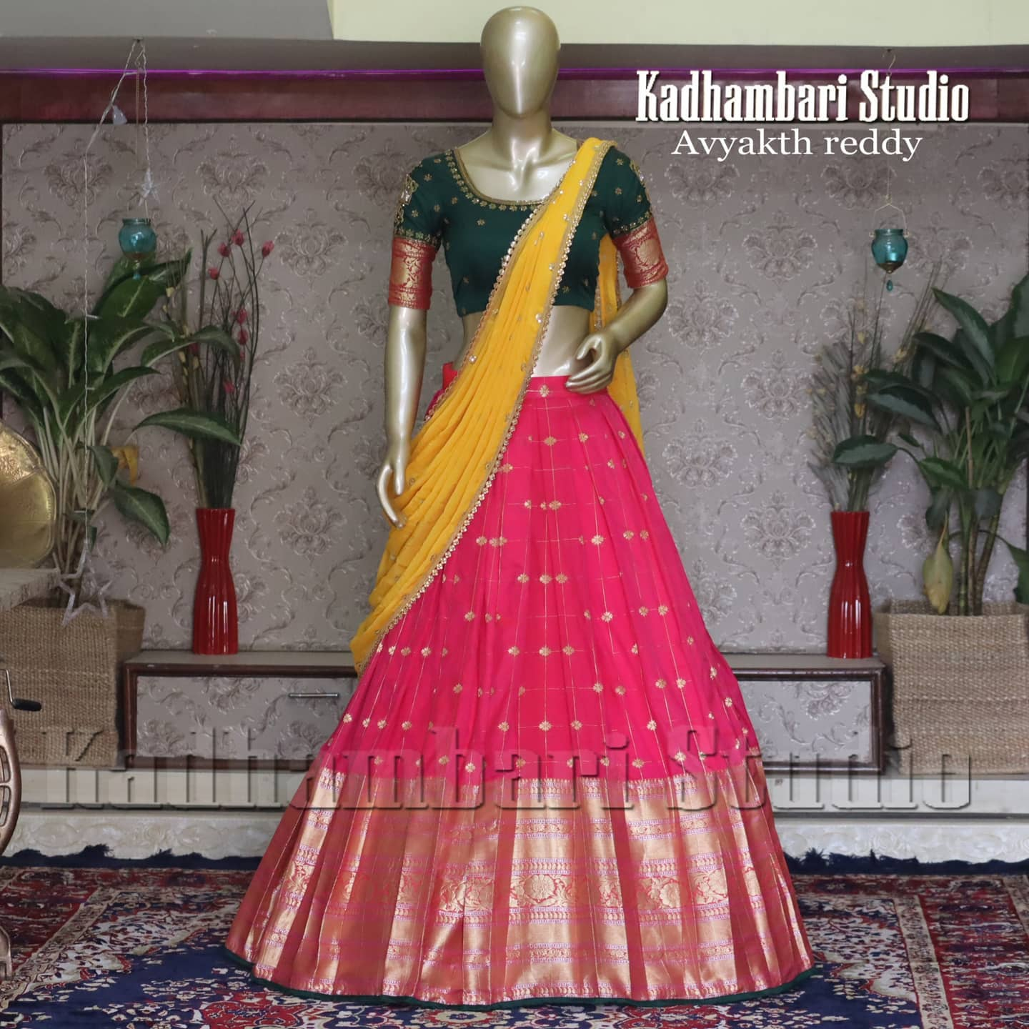 Gorgeous pink color pattu langa and bottle green color blouse with yellow color voni. Blouse with hand embroidery work.  2020-12-31