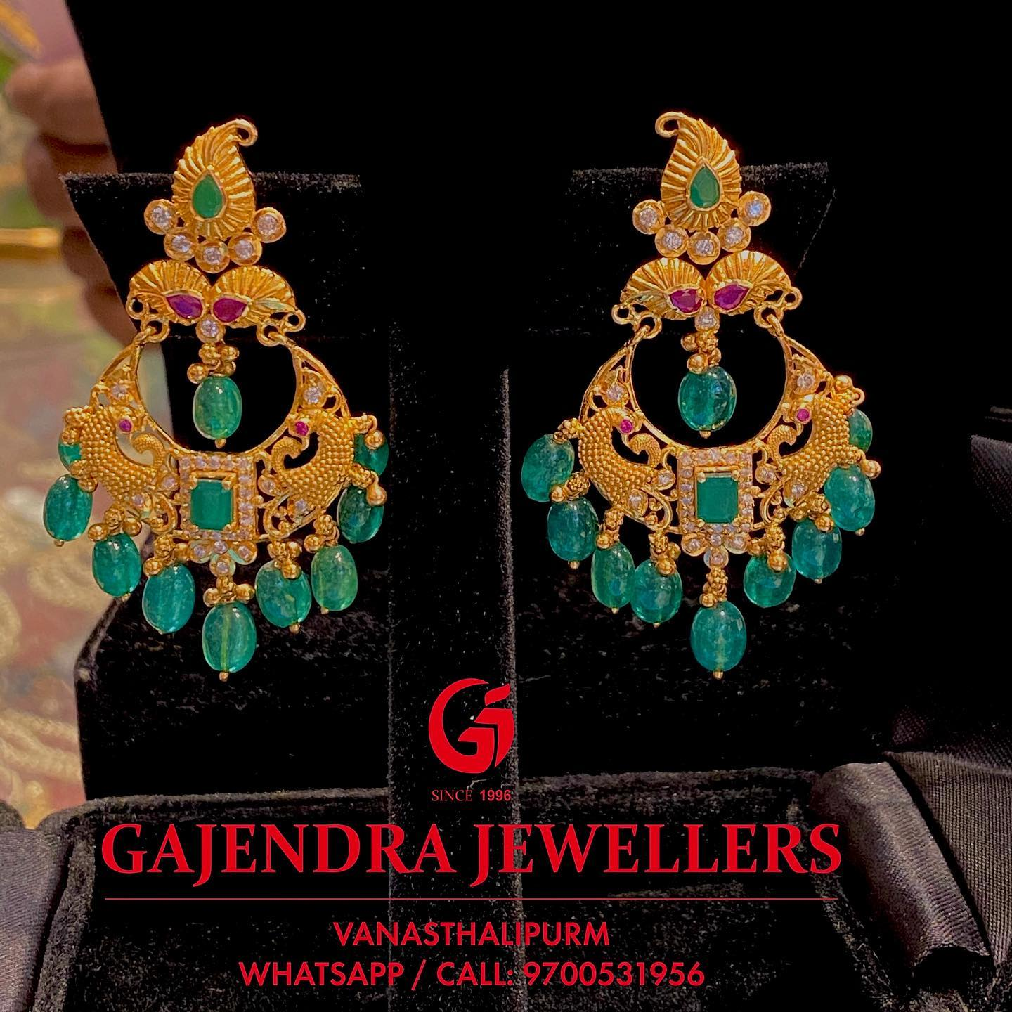Beautiful 22k gold chaandbali studded with rubies and emerald hangings.  2020-12-31