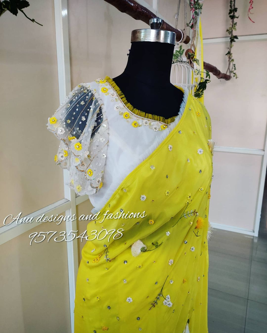 Stunning designer saree and blouse. Blouse with ruffle sleeves. Saree and blouse with 3D hand embroidery work. Saree and blouse cost is Rs.20 500/- 2020-12-31