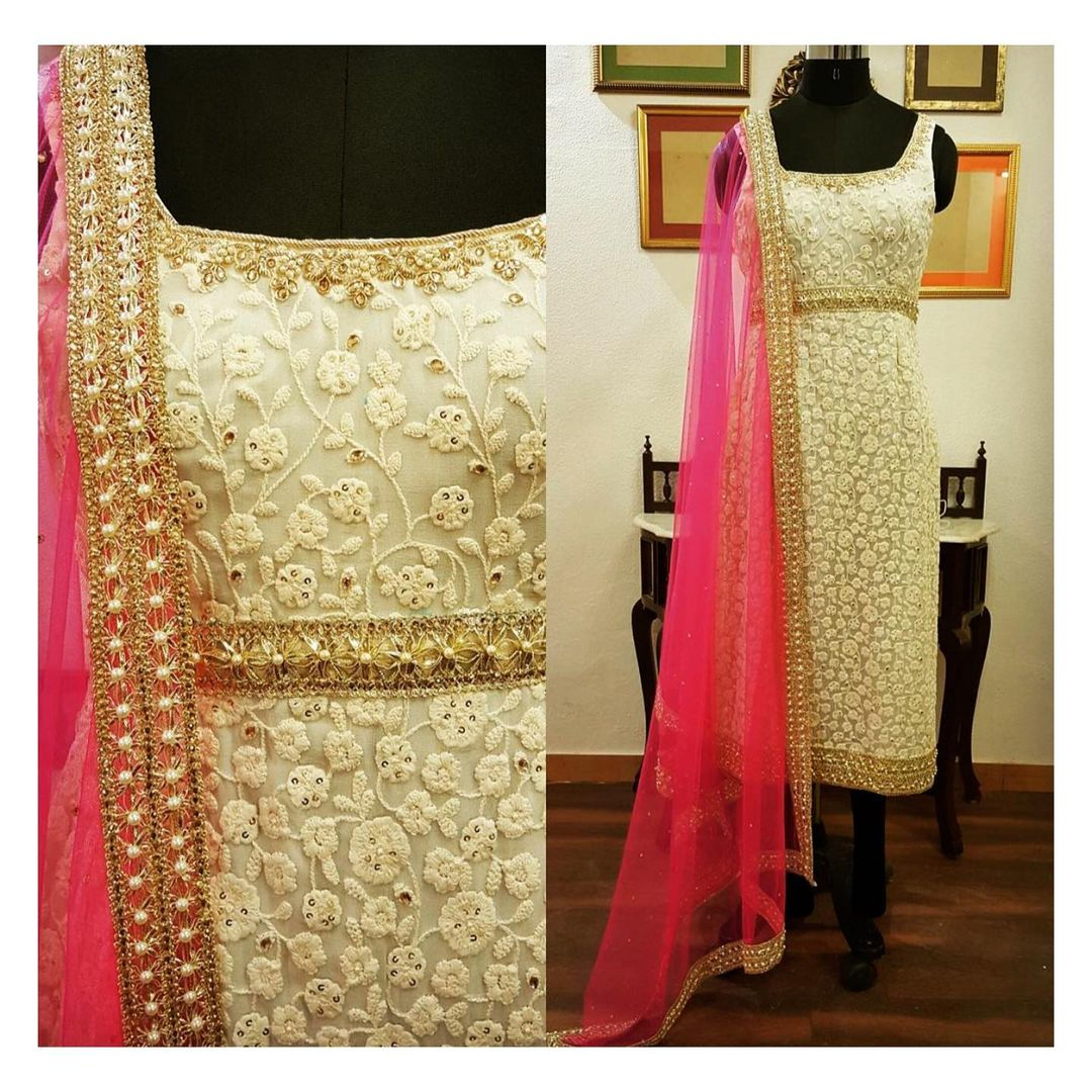 Beautiful off white color straight kurti with Chikankari work and pink dupatta. For enquiry/order contact: shivani@intricado.com