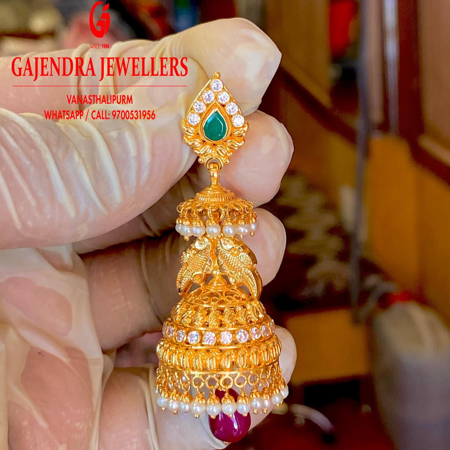 Gorgeous gold jumkhis studded with multi color stones.. 2021-01-01