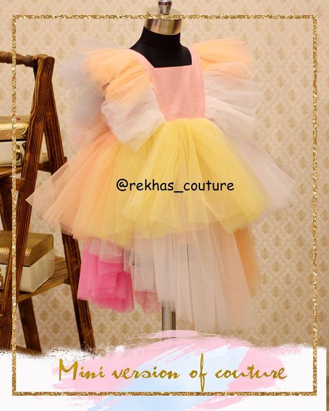 Multi color ruffle kids first bith day gown. 2021-01-01