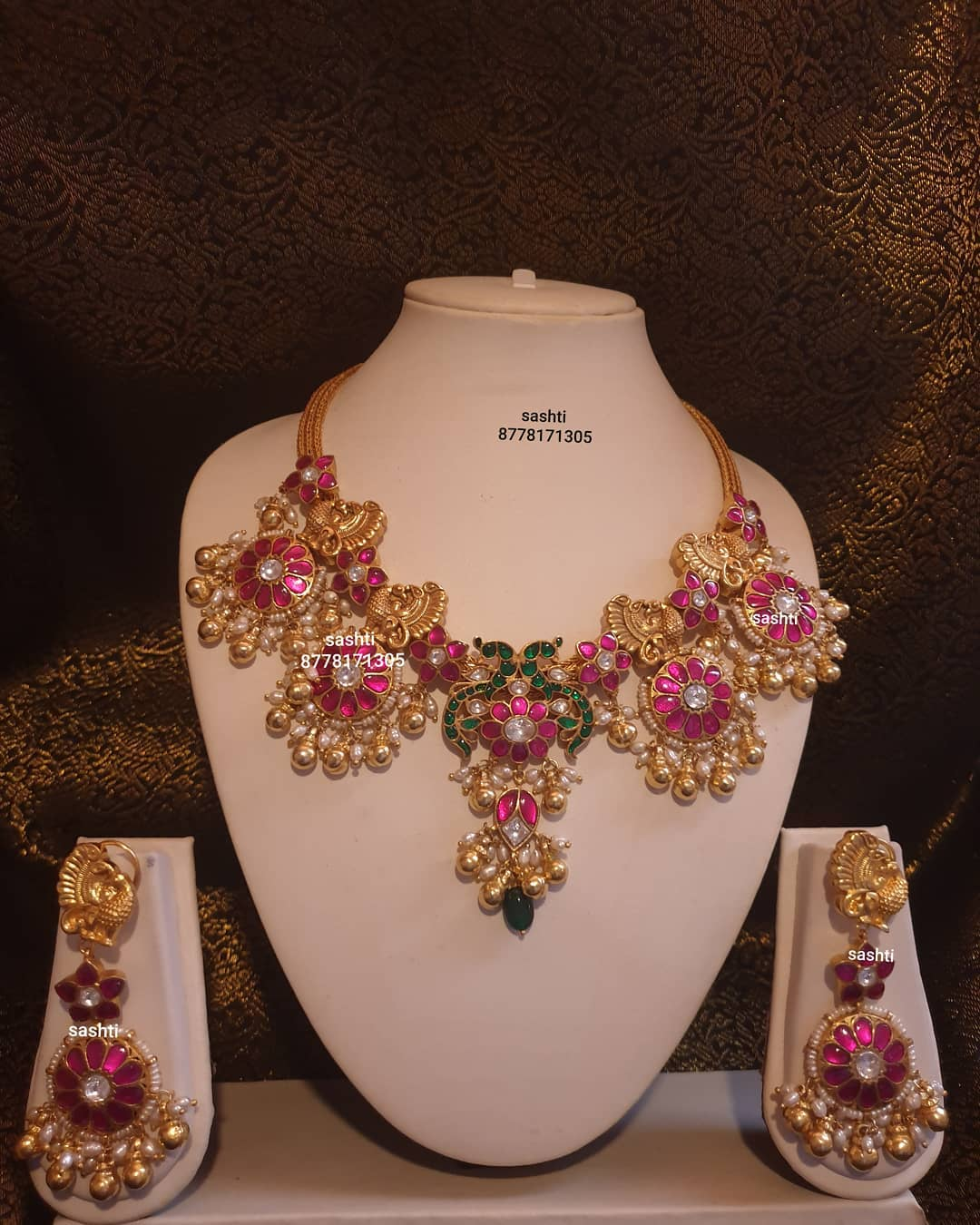 Stunning silver necklace with gold polish. Necklace studded with multi color stones. 2021-01-02