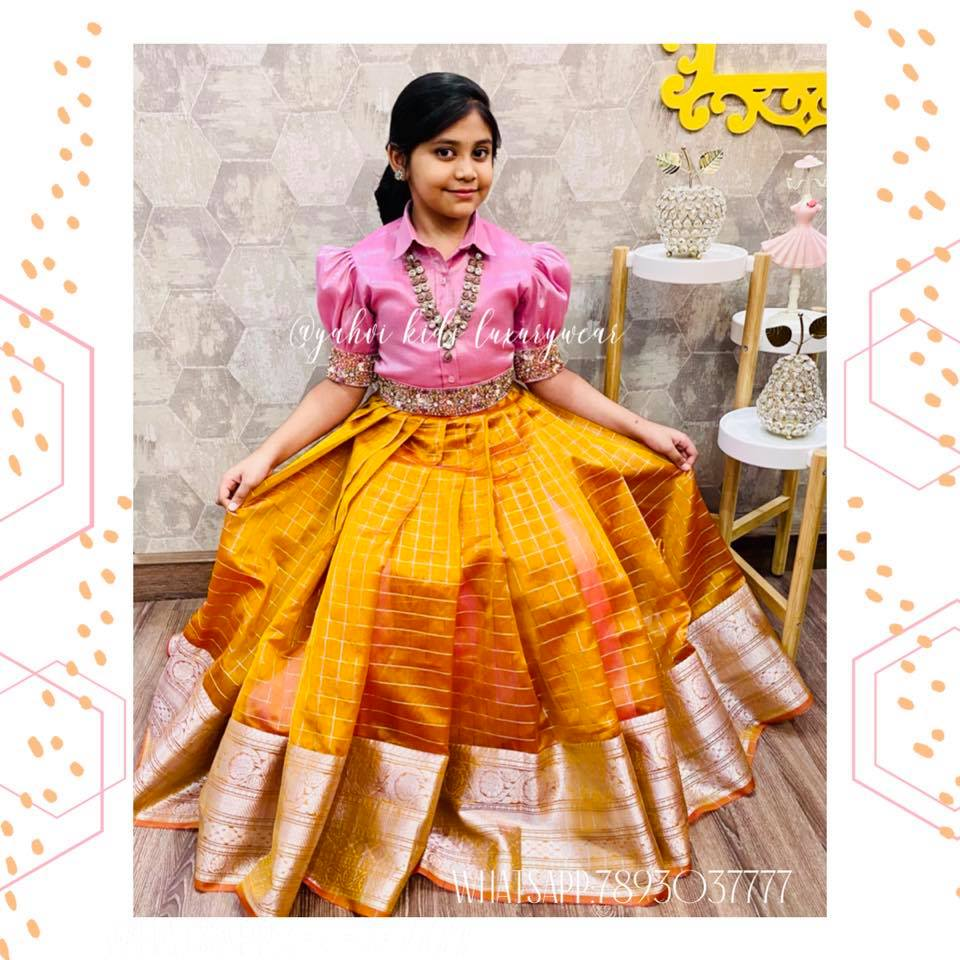 Butta bomma series ..... A baby pink tissue colllar blouse in detailed hand embroidery oversize puff sleeve and detachable work waist belt paired with checks Kanjeevaram kora lehanga. For orders :DM or whatsapp7893037777 2021-01-03
