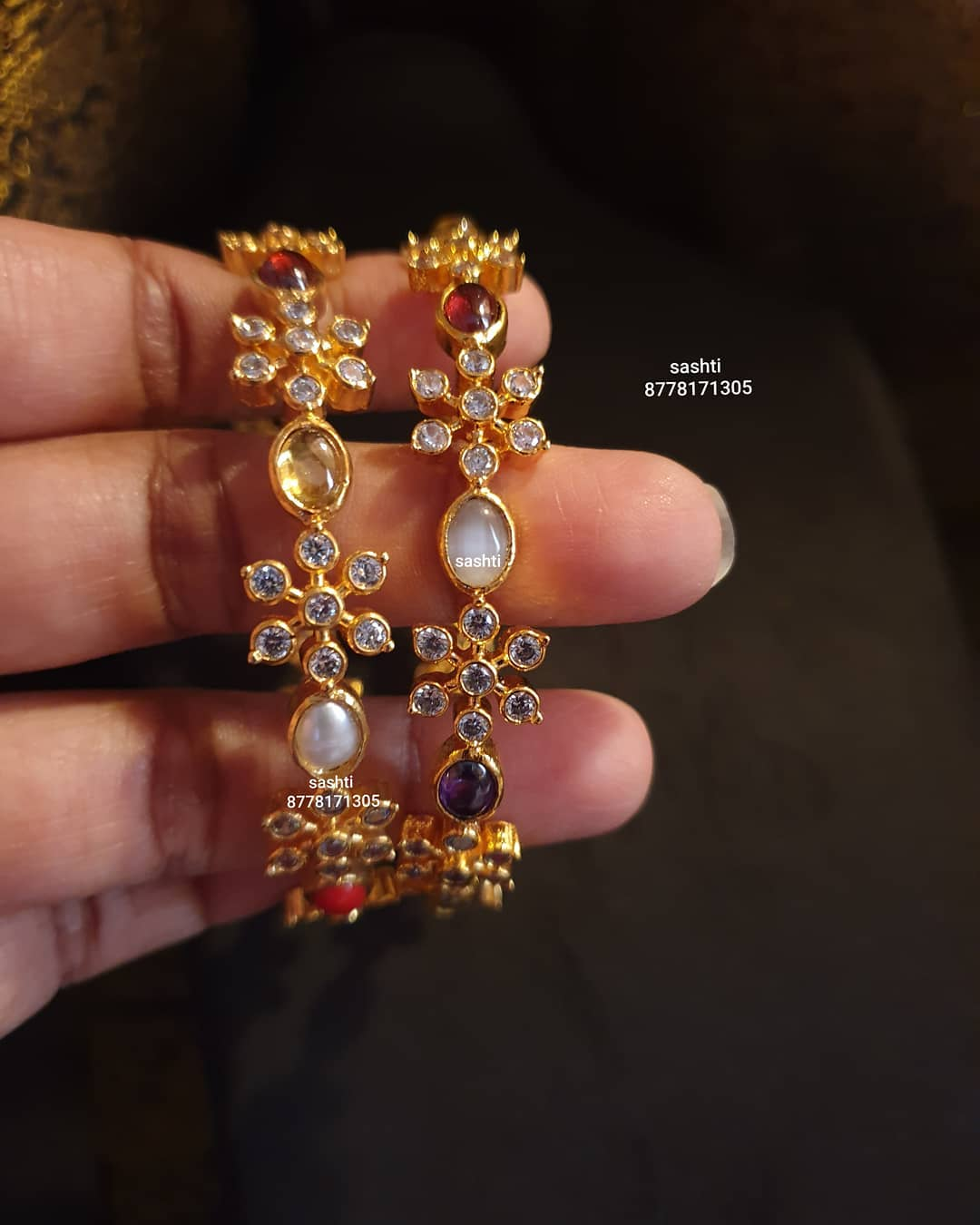 Gorgeous silver bangles studded with multi color stones and navaratan stones. bangles with gold polish. 2021-01-03