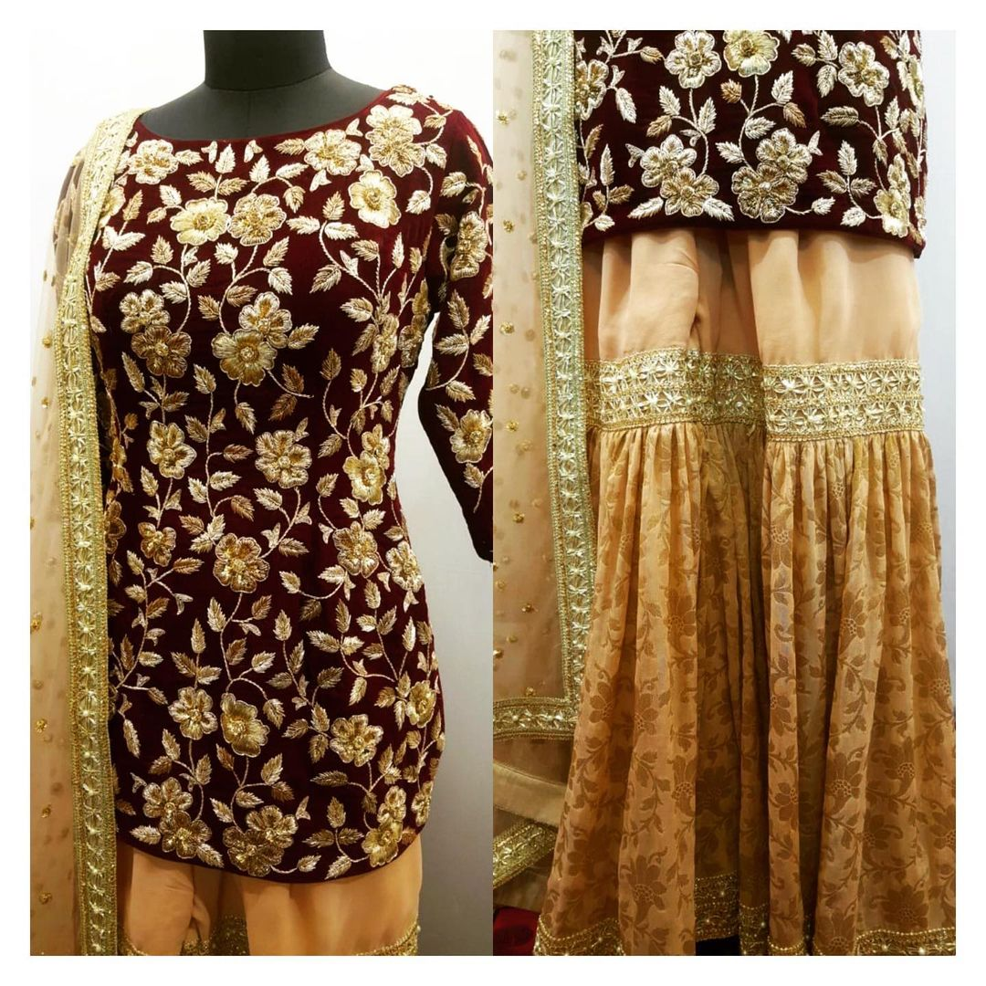 Zardozi hand embroidered kurta in deep maroon silk velvet with pure Banarasi georgette sharara.