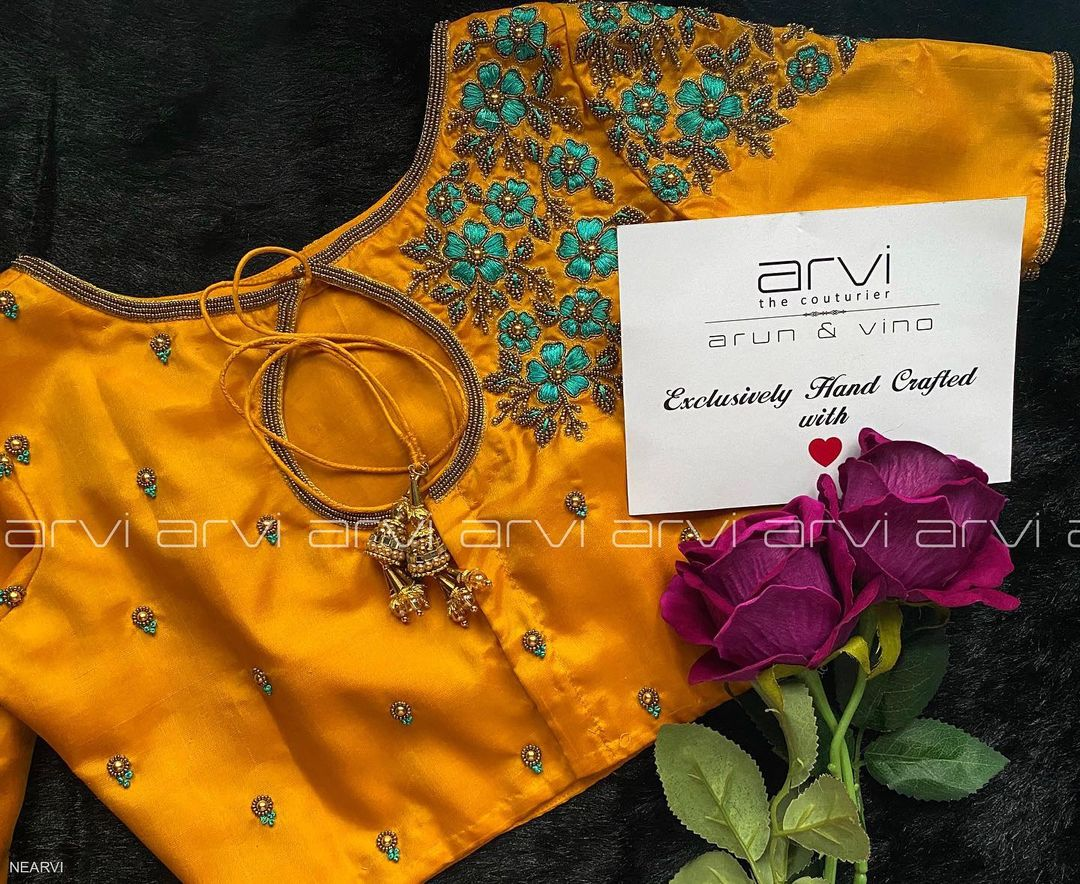 Gorgeous mustard yellow color bridal designer blouse with floral design hand thread hand embroidery maggam work.  2021-01-07
