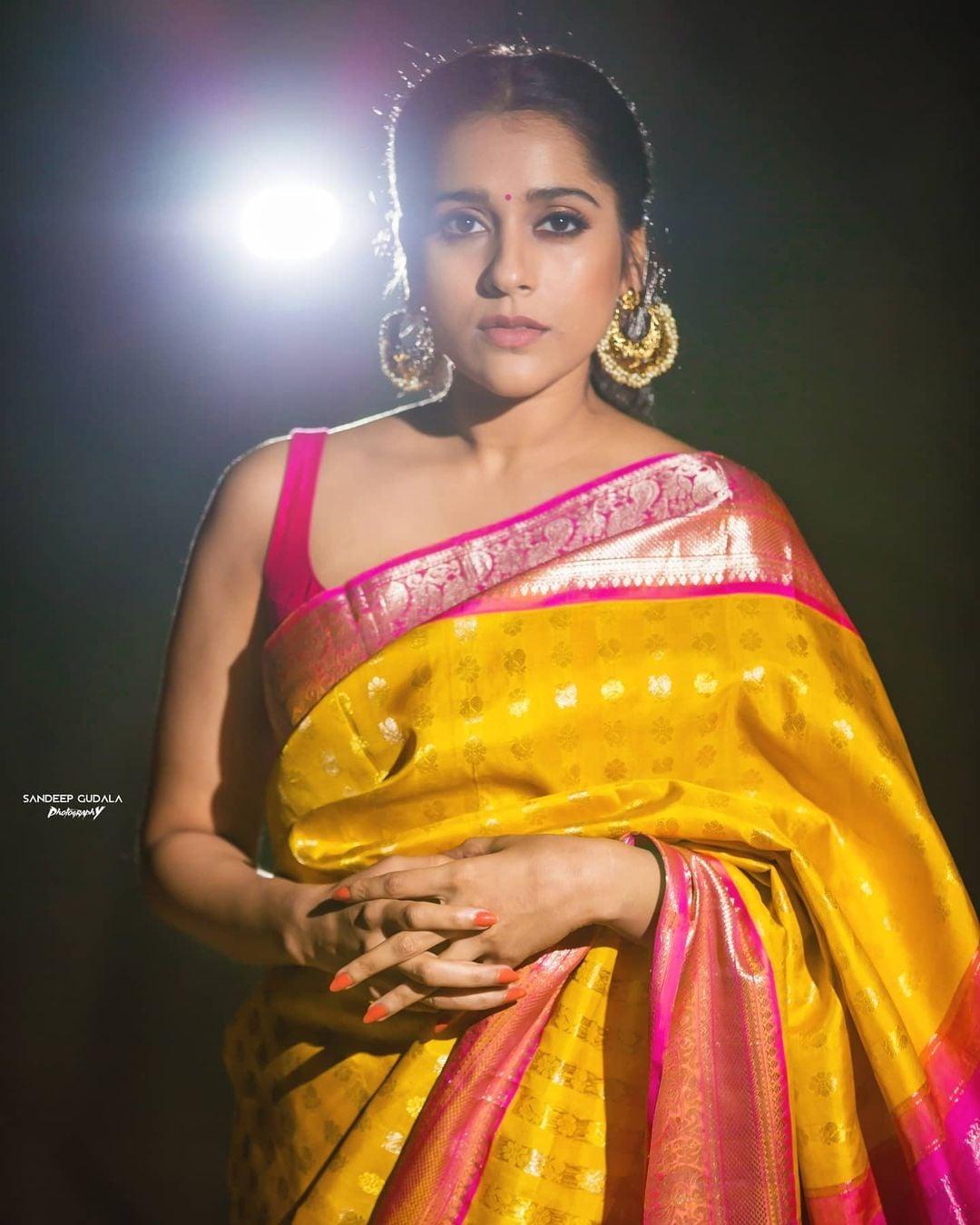 Gorgeous actress and anchor Rashmi Gautham in yellow and pink color combination kanchi pattu saree. 2021-01-09