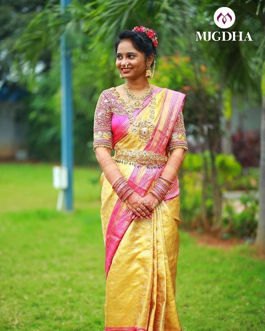 Yellow and pink kanchinpattu saree with golden zari work.is every bride's classic wear.  For orders and enquiries: +91 7993710111. 2021-01-09