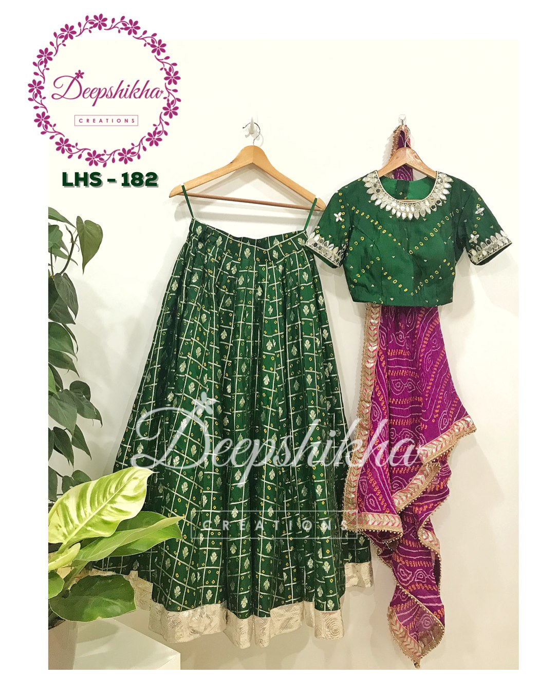 Beautiful bottle green color lehenga and blouse purple color dupatta. LHS - 182