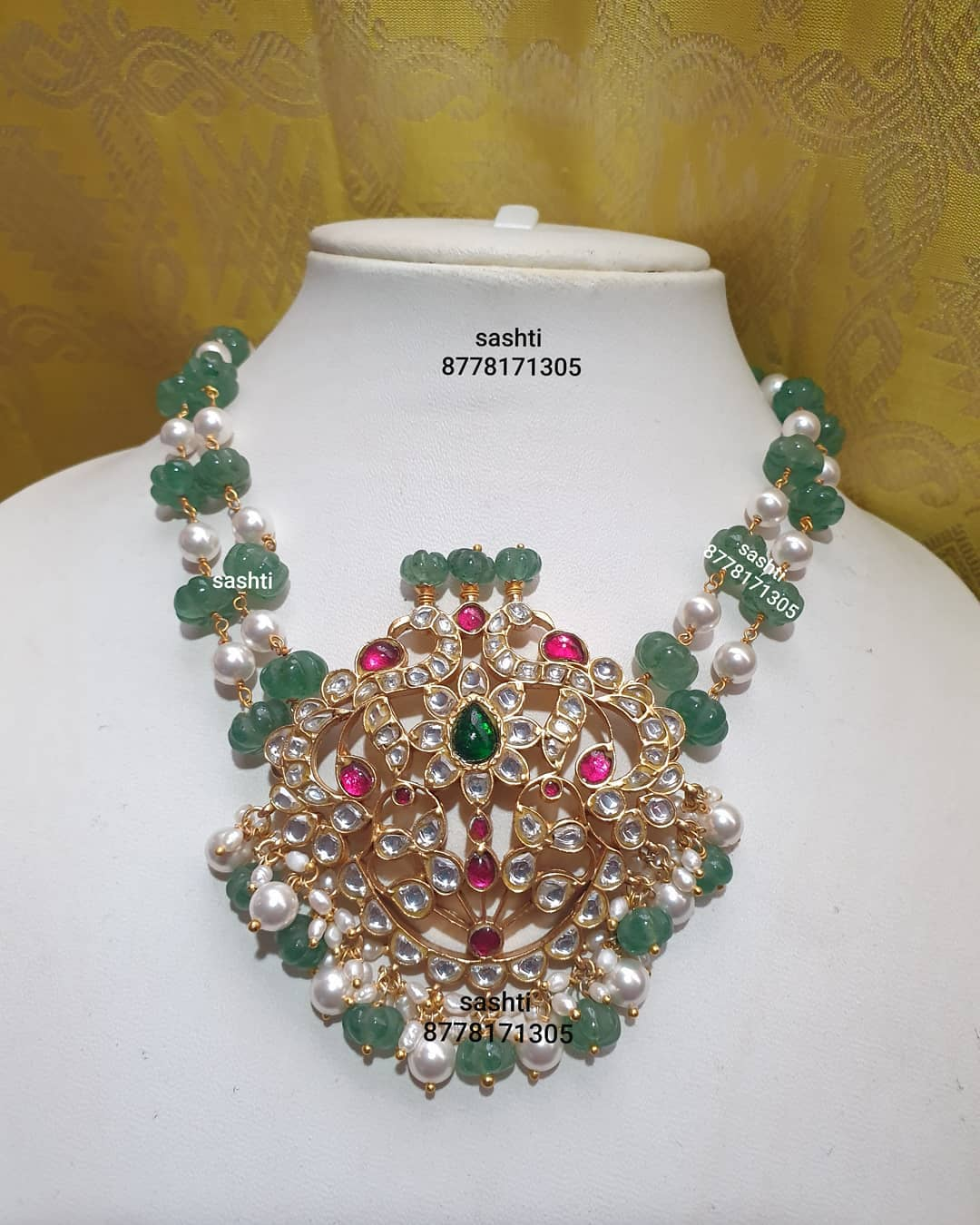 Stunning pearl and emerald necklace with silver peacock pendant. Pendant studded with kundans.  2021-01-10