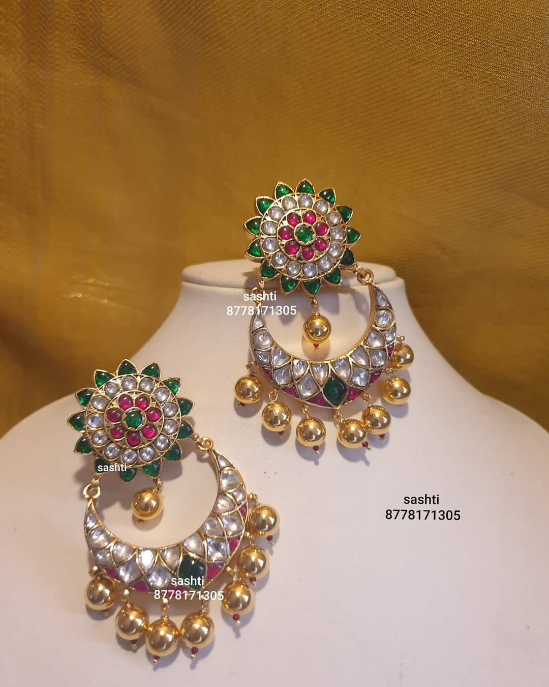 Gorgeous silver chaandbali studded with emeralds and rubies. Chaandbali with gold poolish. 2021-01-10