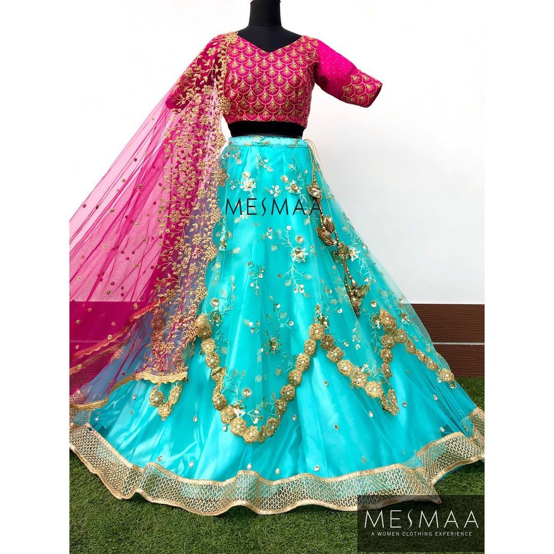 Stunning powder blue color tulle lehenga and pink blouse with net dupatta. 2021-01-10