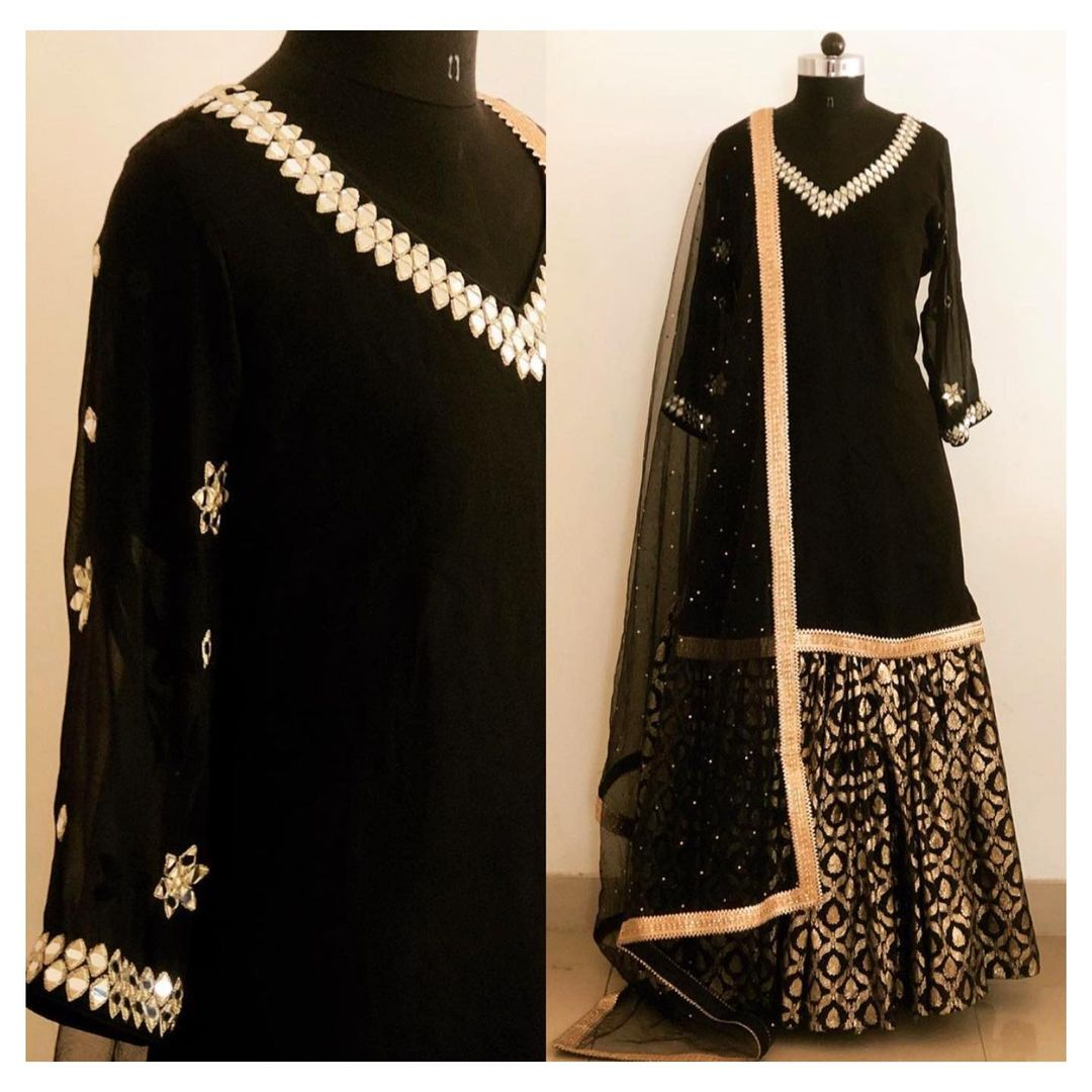 Mirror and gota work sharara in Black chanderi brocade.  For enquiry  email at shivani@intricado.com or  Whatsapp at +918527463626. 2021-01-11