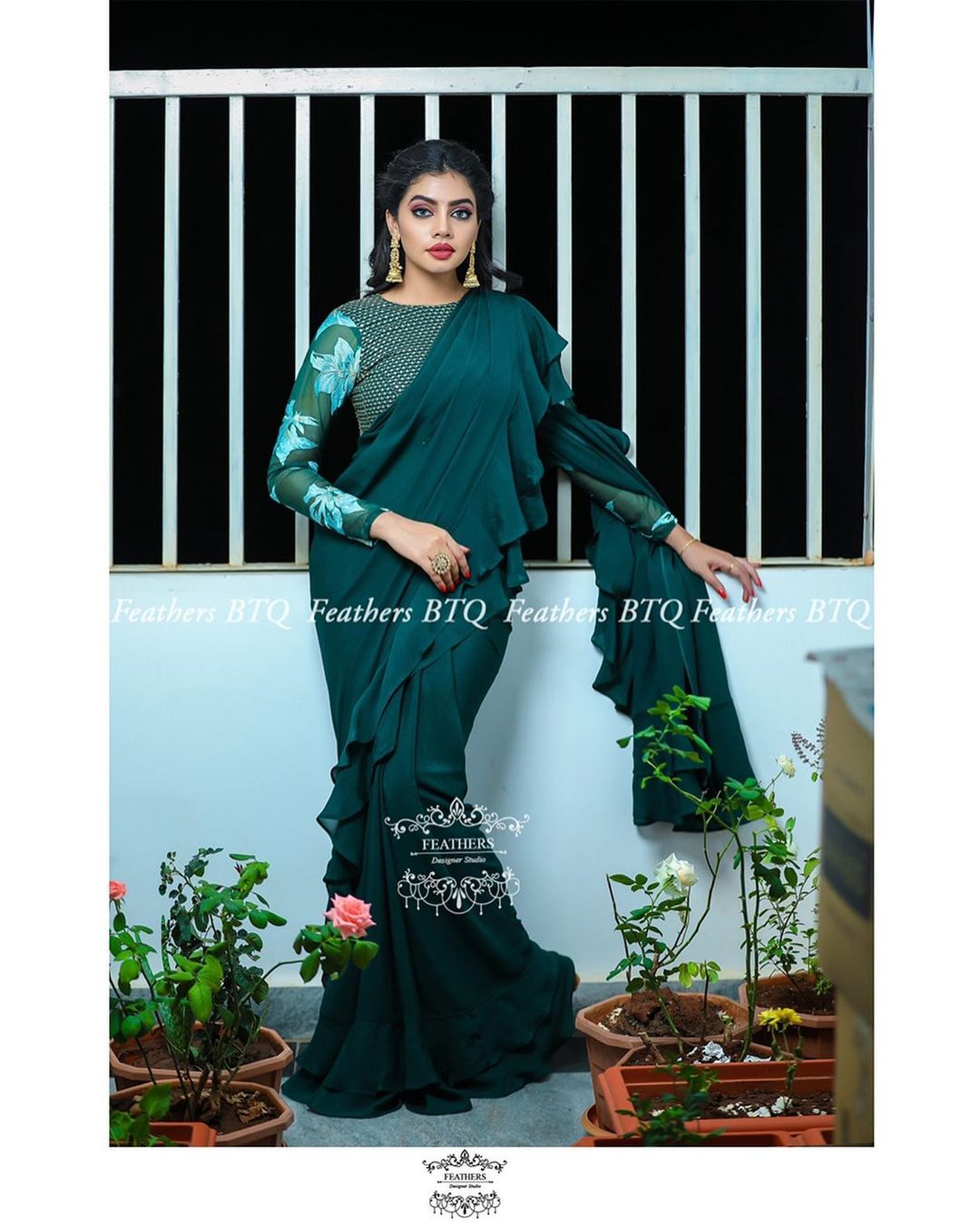 Gorgeous bottle green ruffle saree and floral full sleeve blouse. 2021-01-11