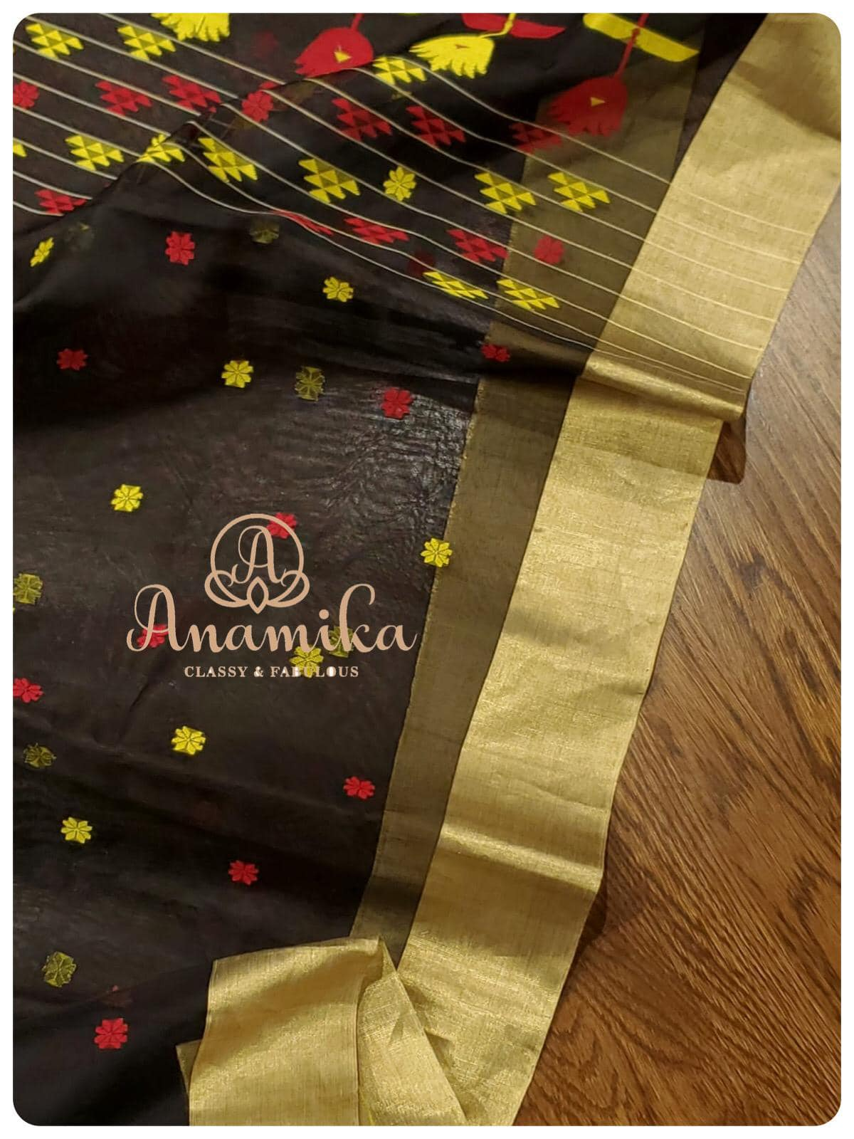 Black makes everything more elegant and classy! A lovely black Chanderi saree with a multi colored pallu - paired with an elegantly designed red hand work blouse. The blouse is so intricately and carefully designed to perfection - that you just can't get over it