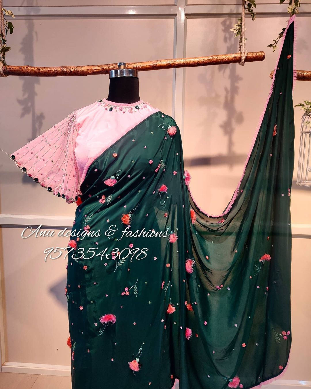 Stunning bottle green color designer saree and blush pink color designer blouse with 3D floral maggam work . Blouse with ruffle sleeve. 2021-01-13