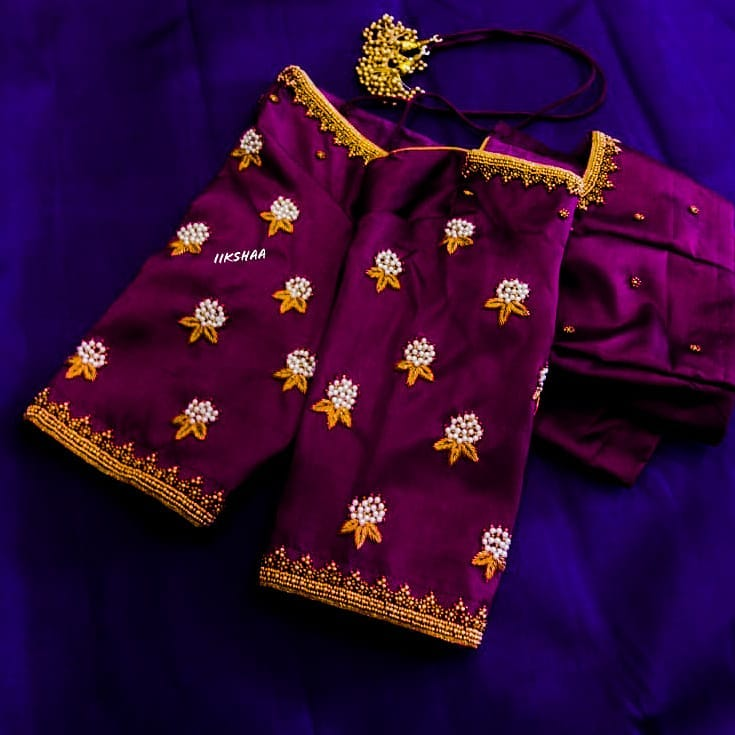 Gorgeous purple color designer blouse with lotus flower buti design hand embroidery aari work allover.  2021-01-16