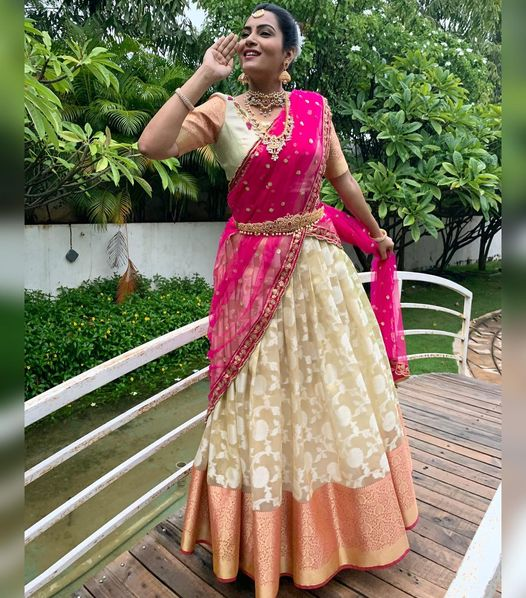 Stunning actress Himaja in off white color pattu lehenga and blouse with net dupatta. Blouse with pattu sleeves.  2021-01-16