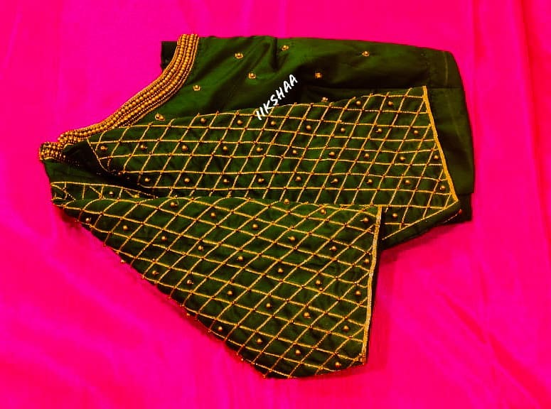 Beautiful bottle green color designer blouse with grid design hand embroidery aari work.  2021-01-19