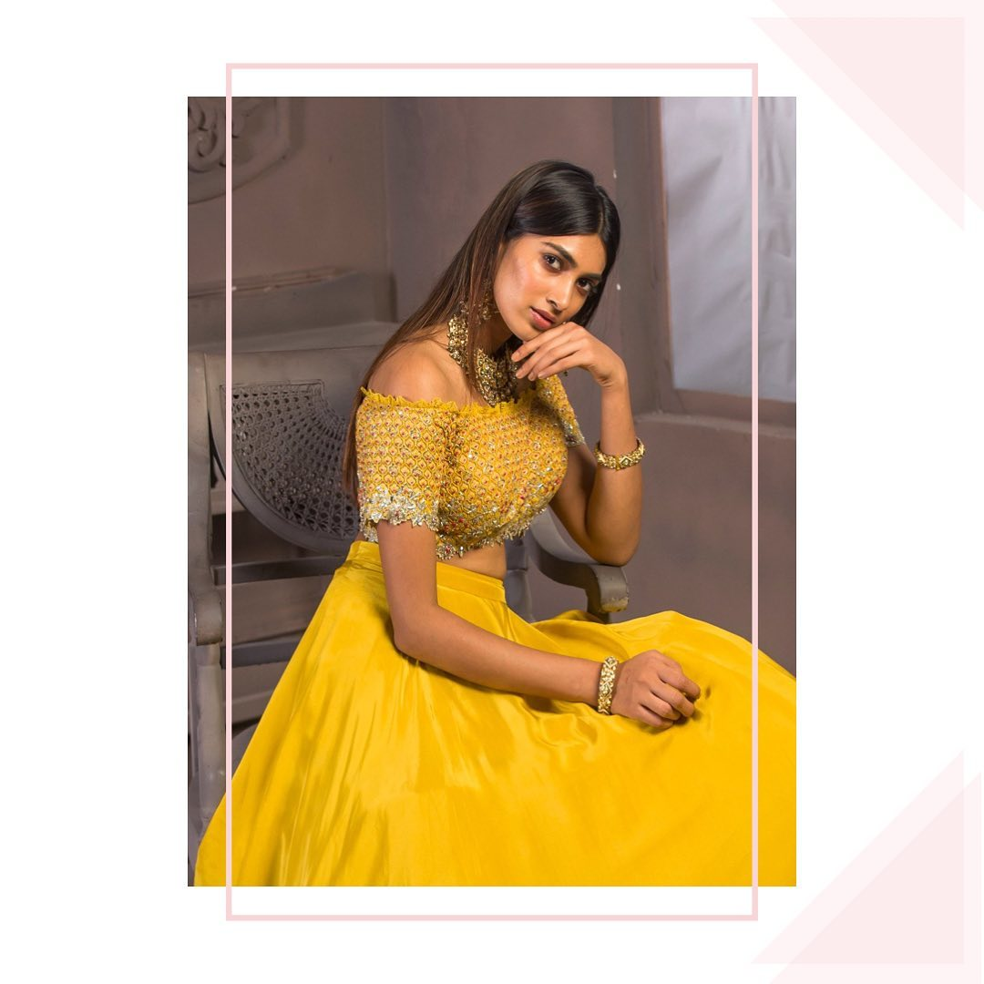 Festive dash of gold shimmer. Stunning sunshine yellow color lehenga and off shoulder blouse. Blouse with hand embroidery work. 