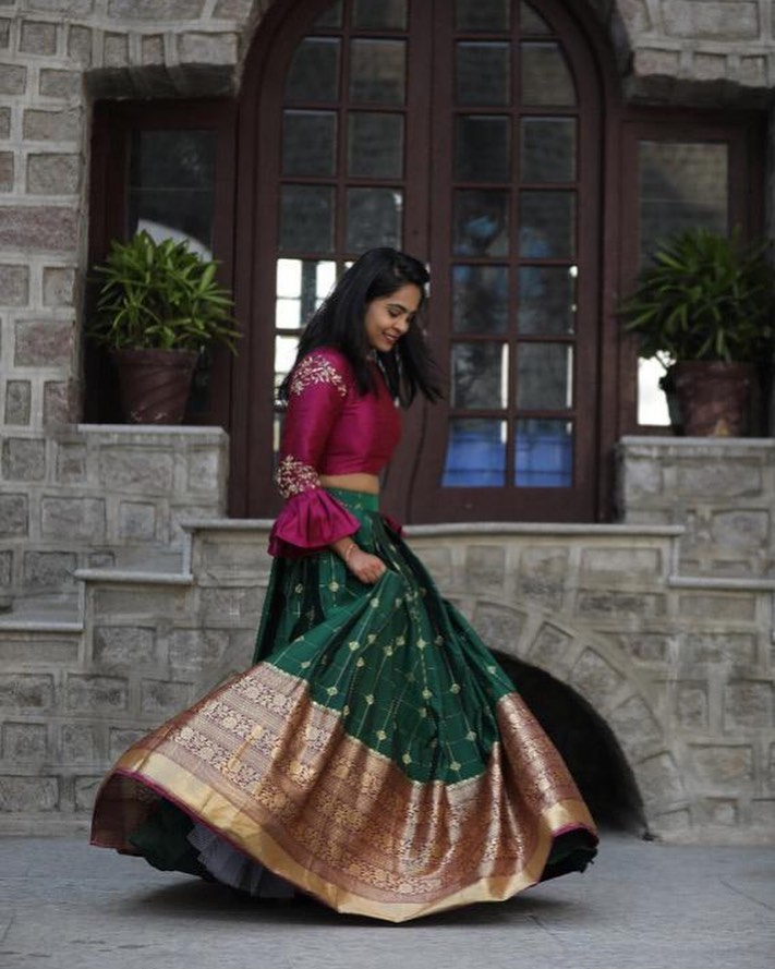 Stunning bottle green color pattu lehenga and purple color crop top. Crop top with bell sleeves. 2021-01-19