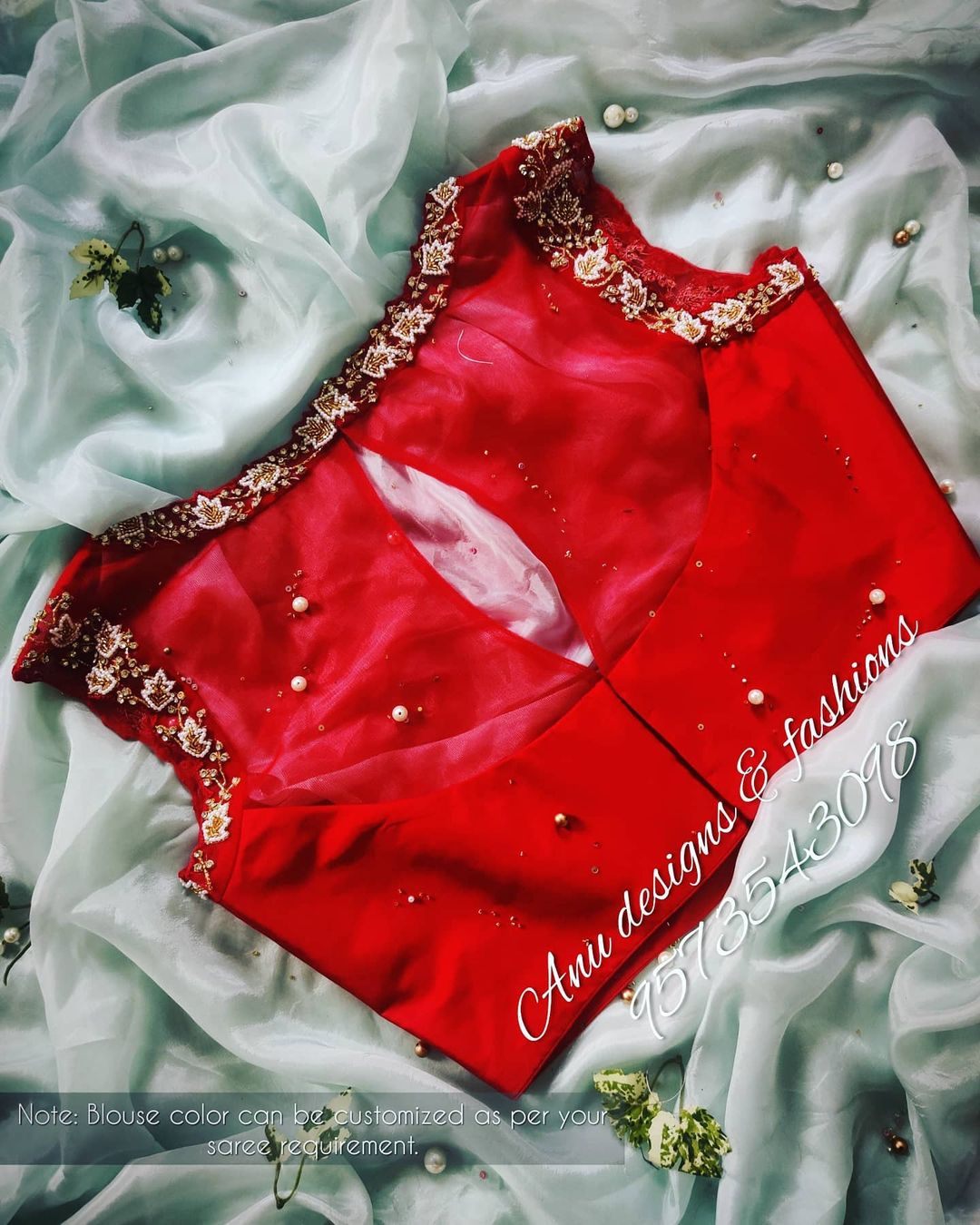 Stunning red color sleeveless blouse with floral design hand embroidery 3D maggam work on neckline.  2021-01-19