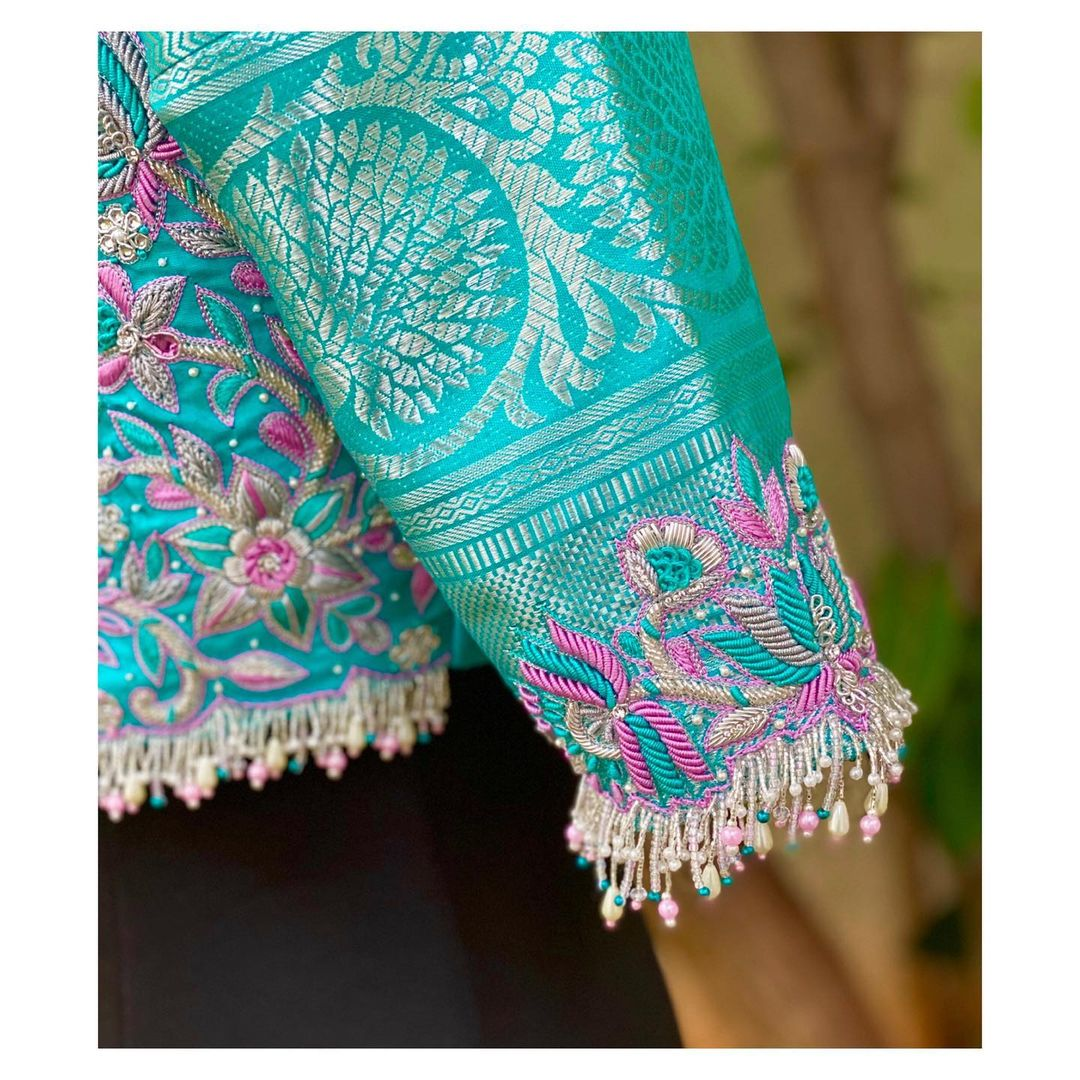 Exclusive blouse detailings!! Gorgeous sea green color designer blouse with lotus flower and creeper design hand embroidery maggam work allover.  2021-01-19