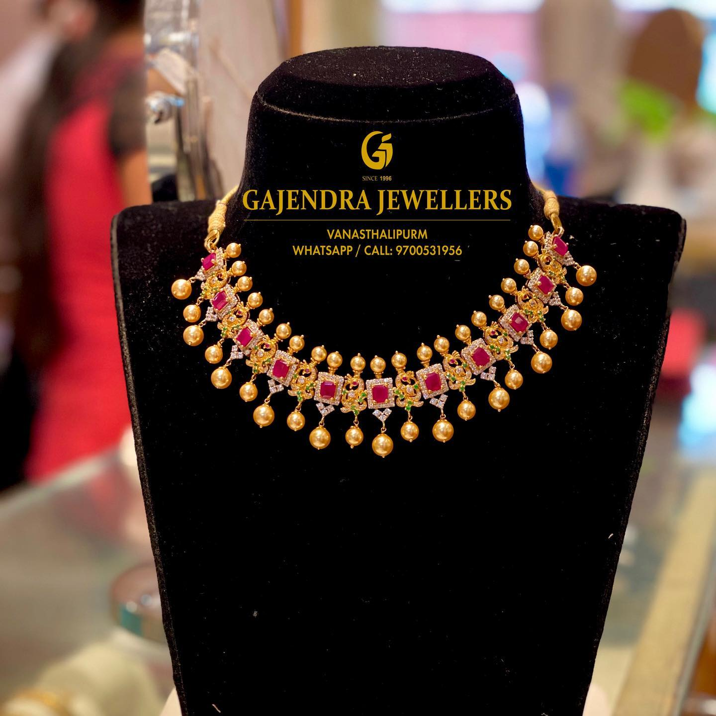 Stunning 22k gold necklace studded with multi precious stones. Necklace with south sea pearl hangings.  2021-01-20