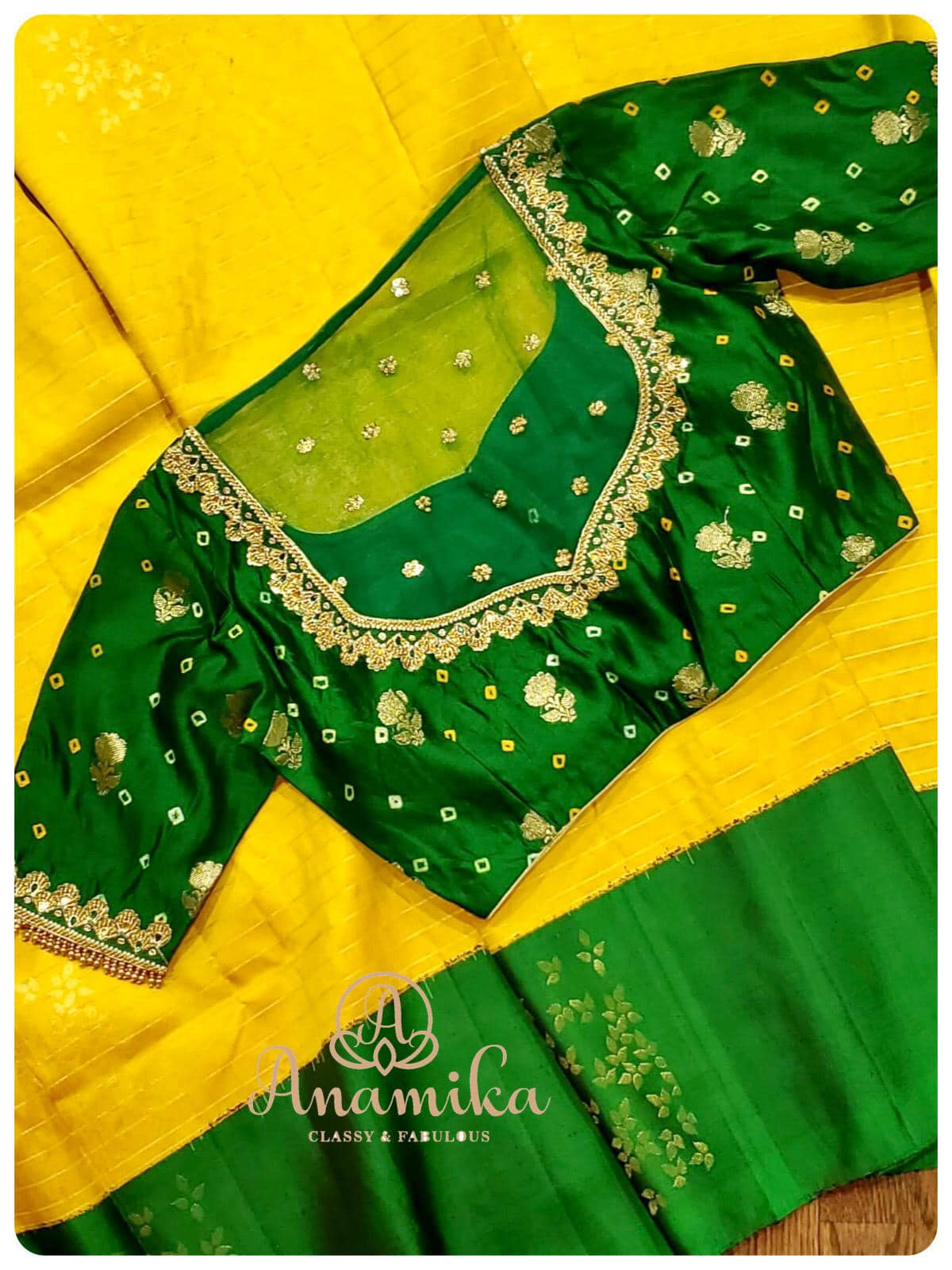 A traditional saree with yellow and green combination is always a stunning classic  A true beauty  this borderless kanchi silk saree paired with a bandini pure silk fabric blouse with intricate maggam work makes the saree look beautiful and very to carry as well 2021-01-20