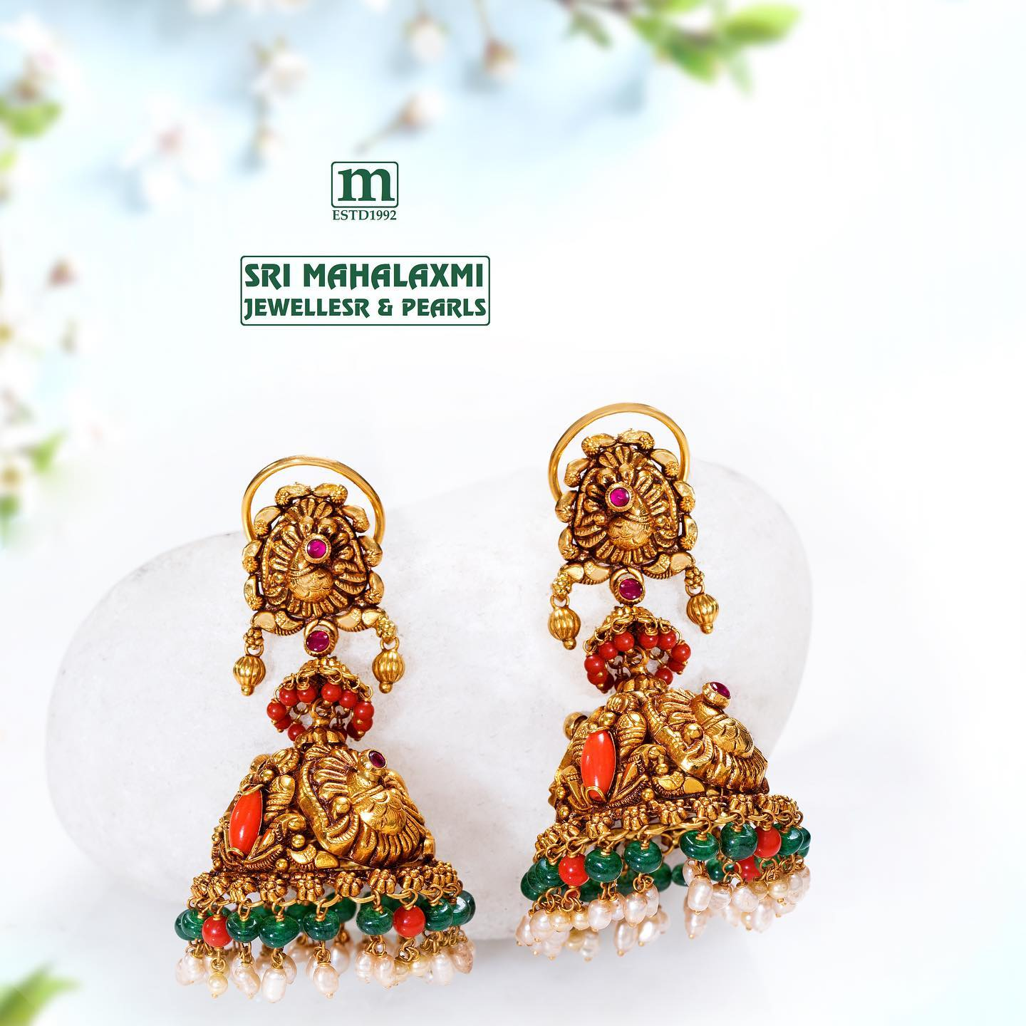 Beautiful nakash jhumka studded with coral emerald and pearls.