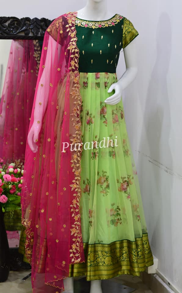 Stunning bottle green and parrot green color combination pattu long frock with net dupatta. 2021-01-22