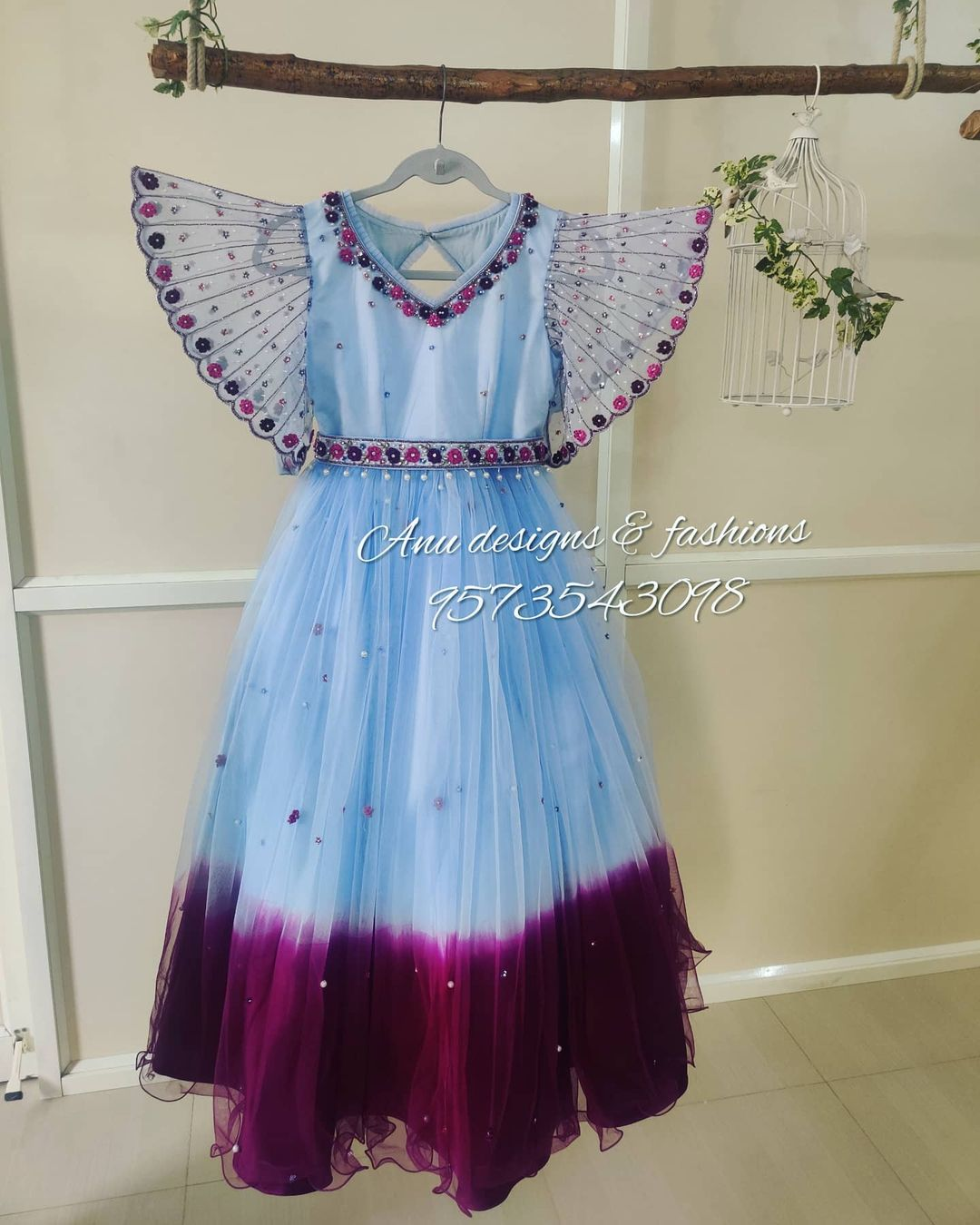 Gorgeous ice blue and wine color designer kids gown with ruffle sleeves. 2021-01-22