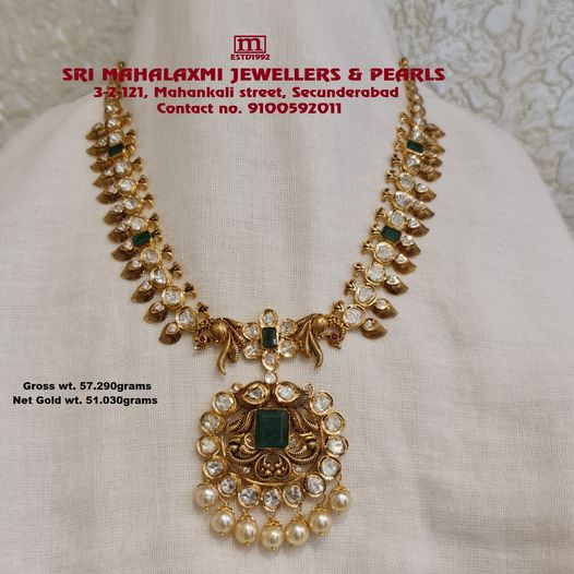Presenting here is Nakshi Mango Necklace studded with best quality Flat Diamonds(Polki Diamonds) Emeralds and South Sea Pearls. Visit showroom for widest range of collection in Necklaces at Most Competitive Prices. Call / Whatsapp  on 9100592011. 2021-01-24