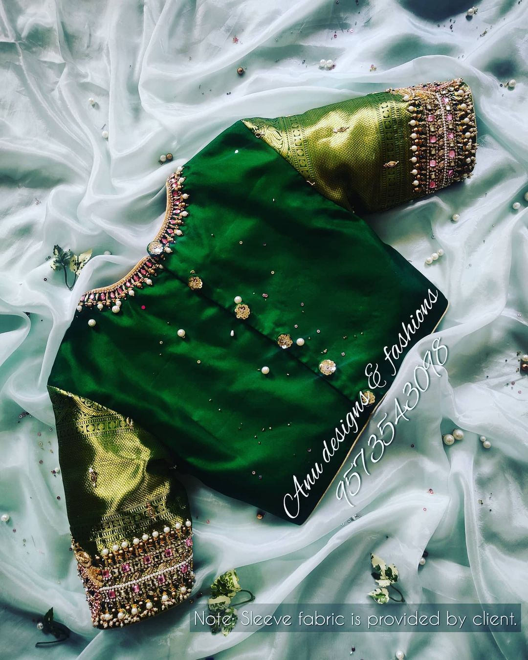 Lovely leaf green color designer blouse with jewel theme hand embroidery aari work.   2021-01-24