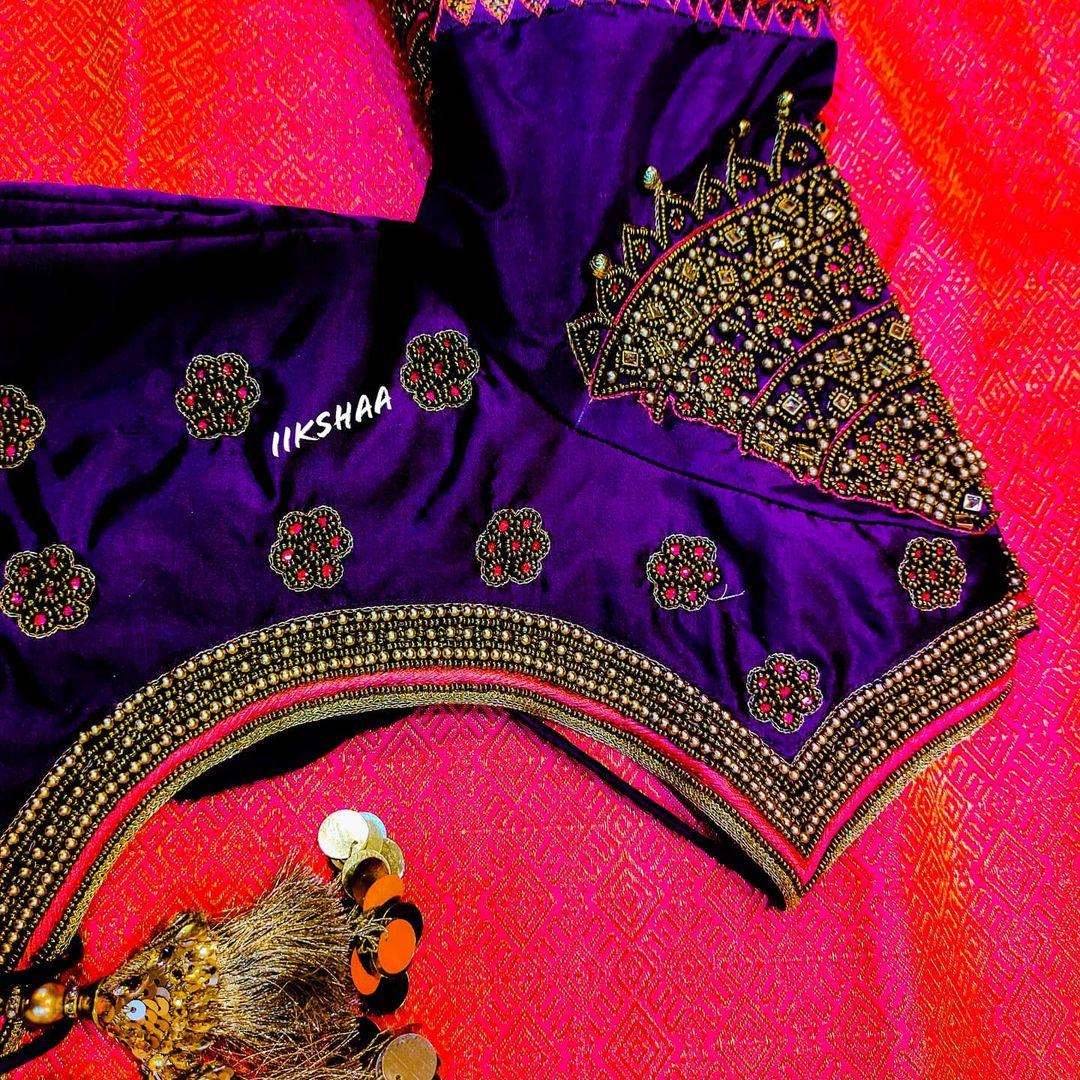 Gorgeous purple color designer blouse with peacock bead aari work on sleeves. 2021-01-24