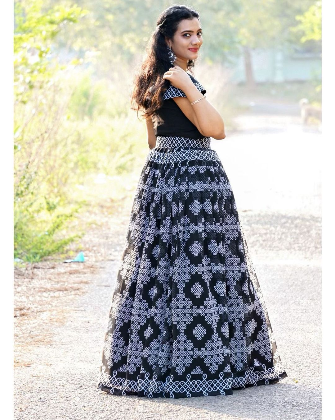 Stunning black color skirt and off shoulder crop top with muggu print. 2021-01-24