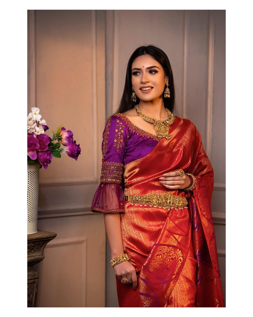 Lovely purple color designer blouse with bell sleeves and aari work.  2021-01-24