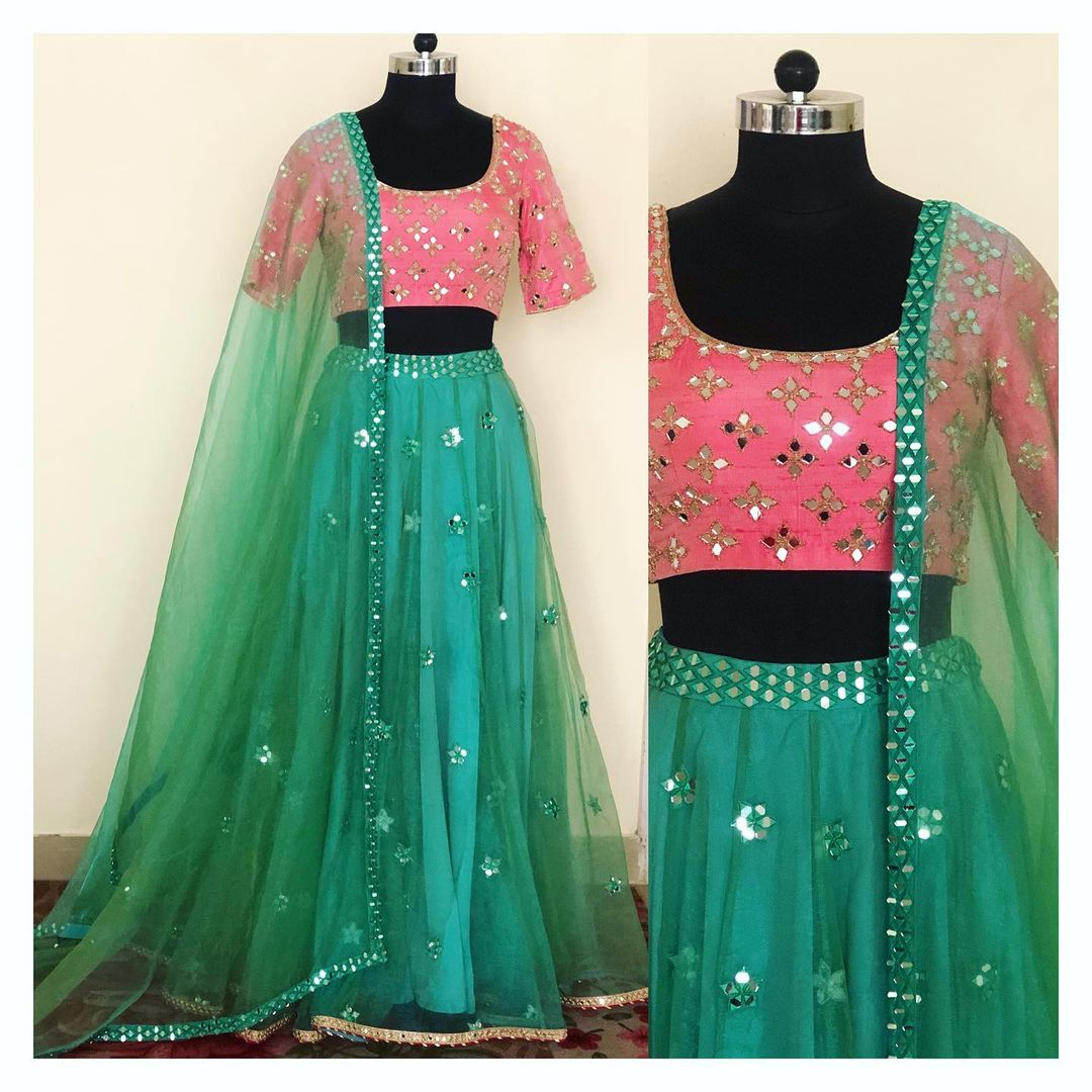 Mirror and zardozi hand embroidered lehenga in silk organza. Can be customised in any color and size.  For enquiry/order  shivani@intricado.com or Whatsapp:- +91 8527463626. 2021-01-24