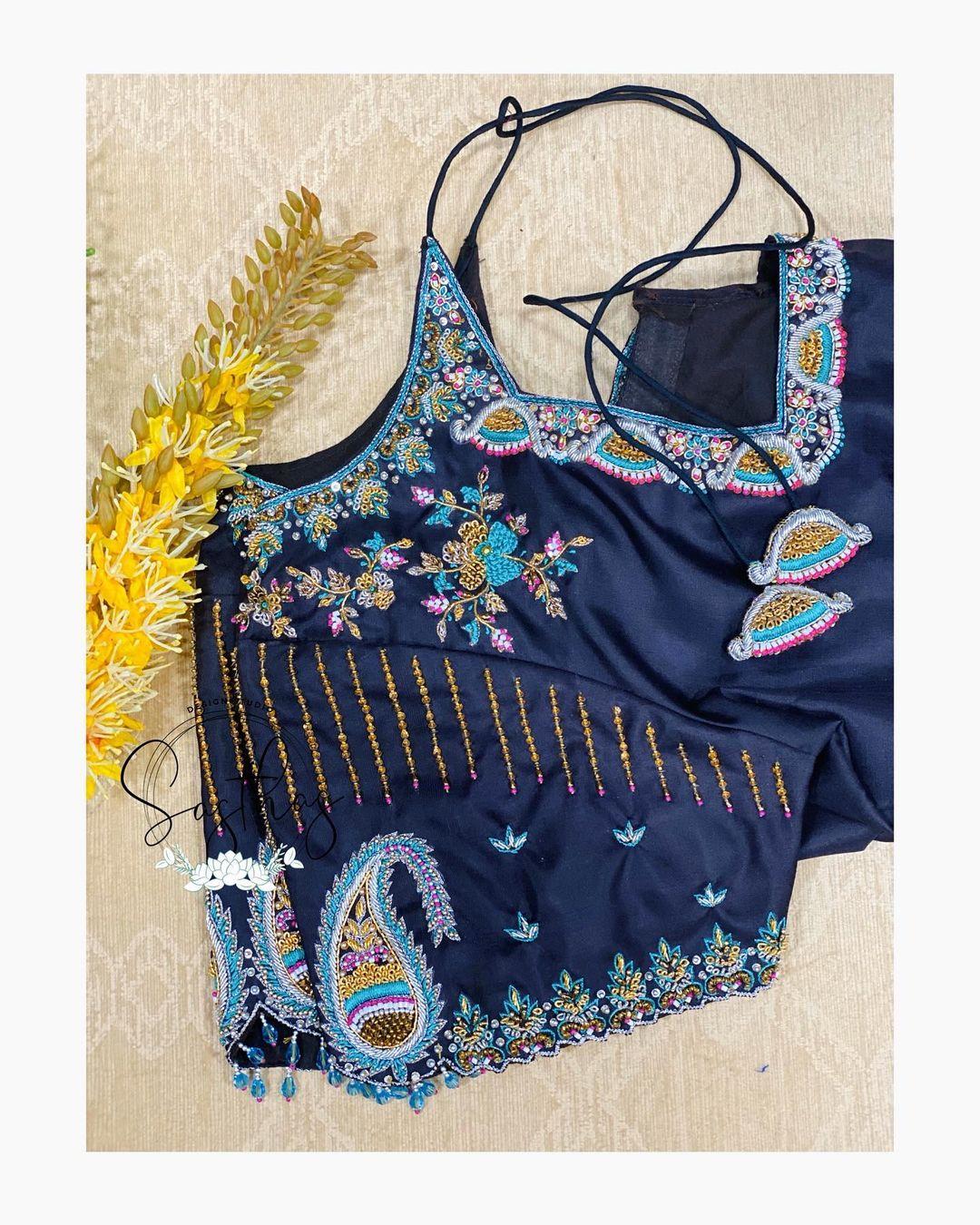 Gorgeous eggplant color designer bridal blouse with floral design multi color thread aari work. 2021-01-26