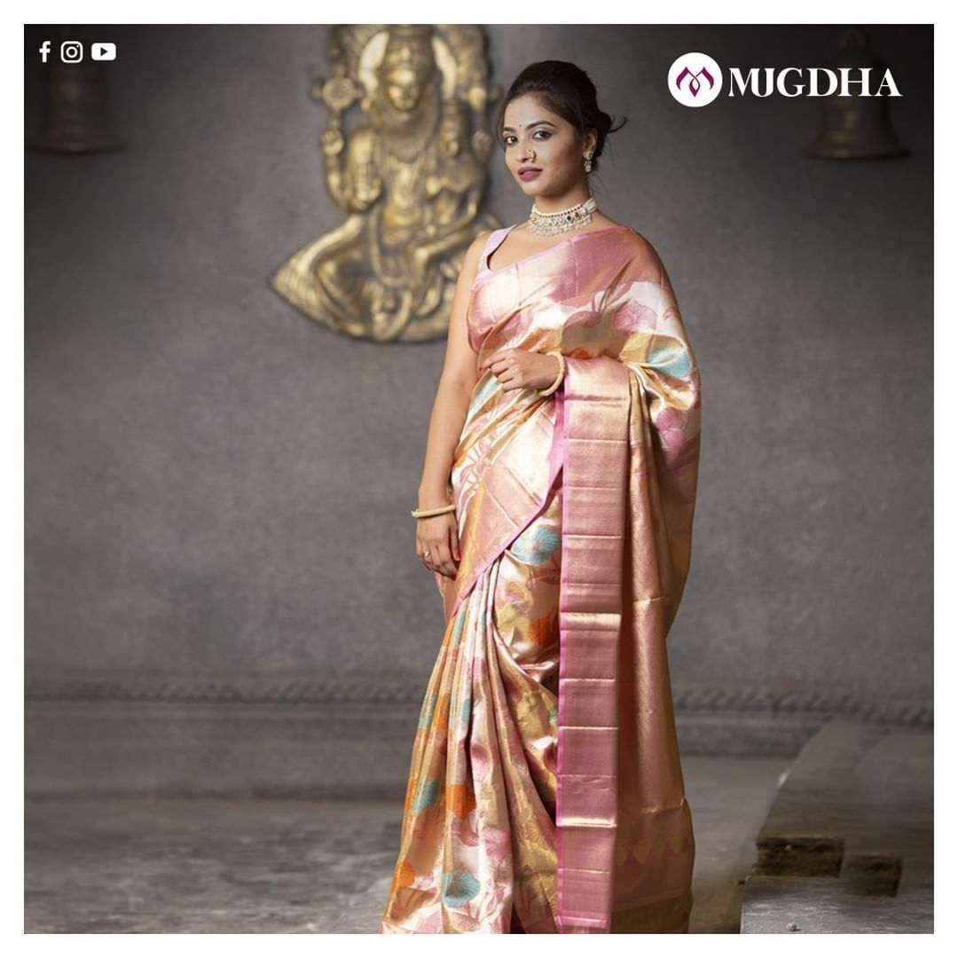 Beautiful pastel pink shade kanjeevaram saree adorned by beautiful Harika.  The perfect zari work across the border is an absolute pick for your special day. The grand look is shown over you once draped royally. 2021-01-26