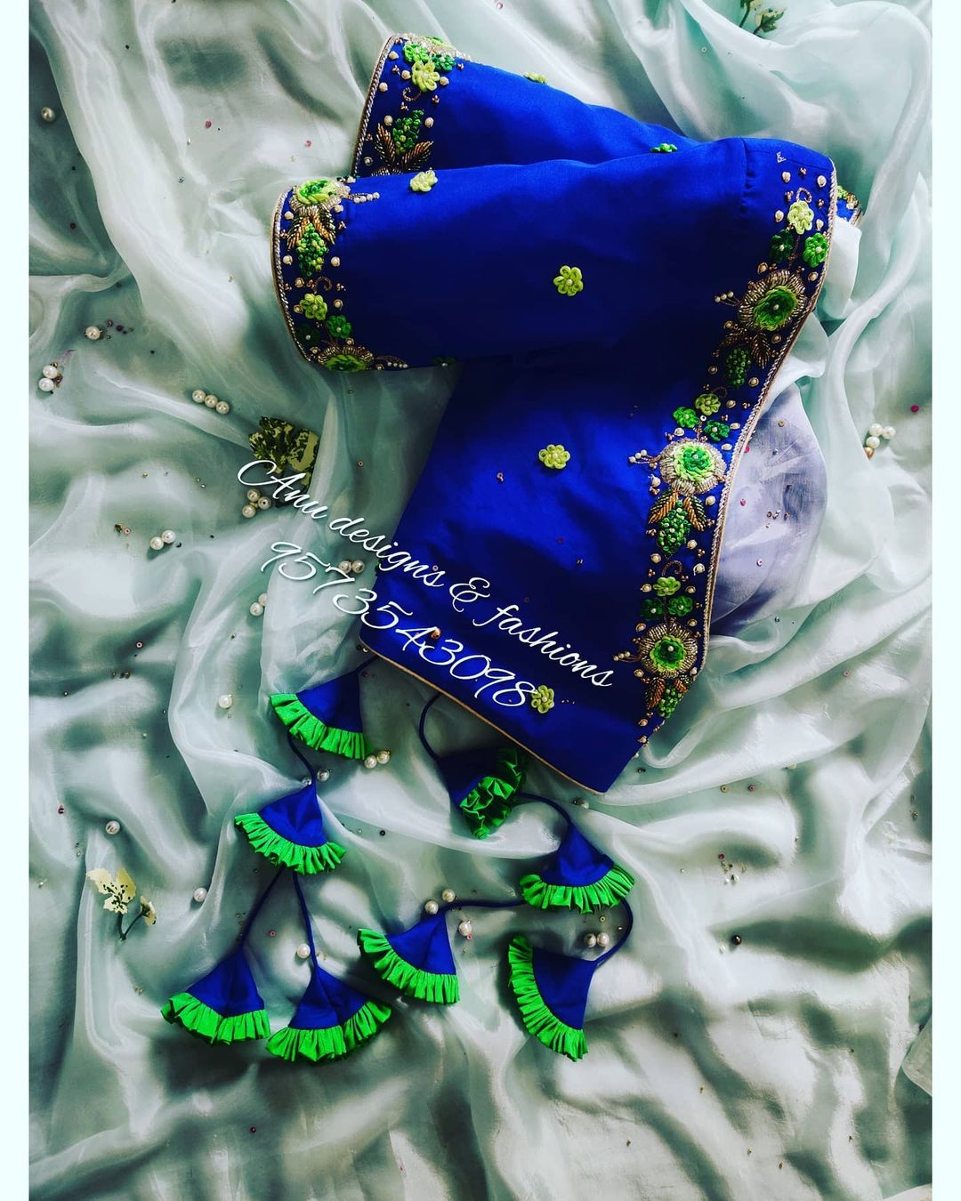Stunning royal blue color designer blouse with 3D floral design hand embroidery maggam work.  2021-01-26
